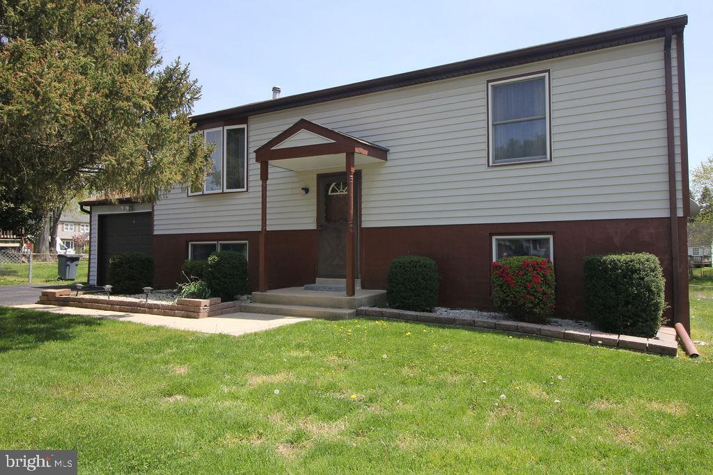 Welcome Home to this 4 Bedroom, 2 Bath Split Level on  a beautiful cul-de-sac in Elkton! This home h