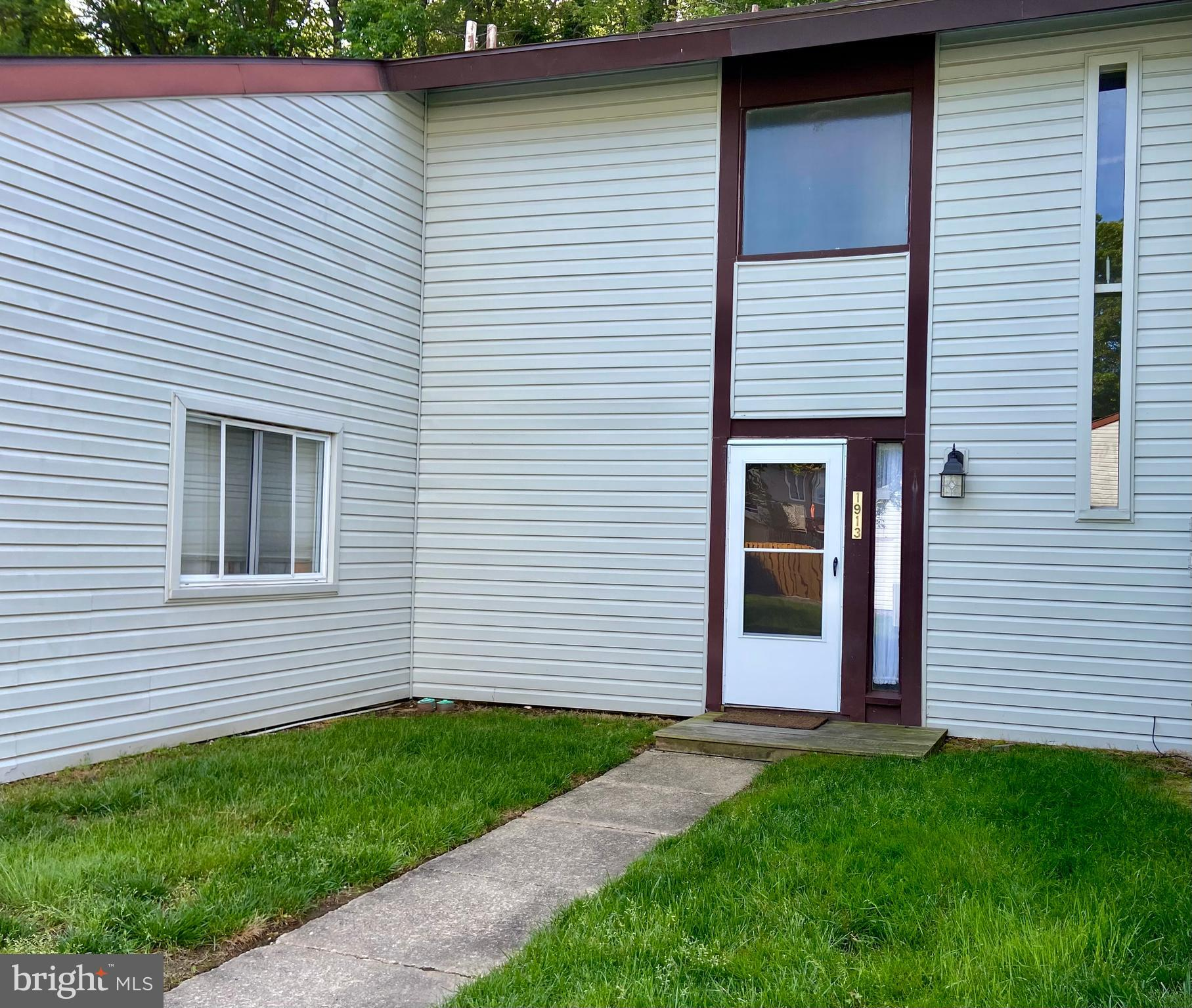 Wonderful 2 Bedroom, 1 bath condo with 1 car garage. Backs to woods. Updated kitchen with granite counters. Pergo flooring throughout main level. Fenced yard with large deck.  Bring your TLC to this unit!