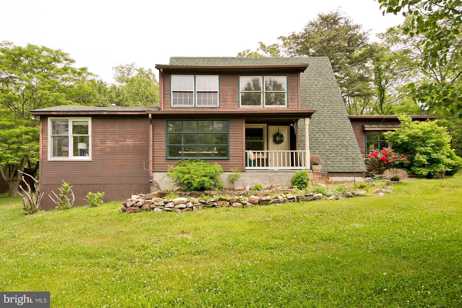Enjoy country living on this partially wooded double lot. 2 Bed/1 Bath chalet with covered front & b