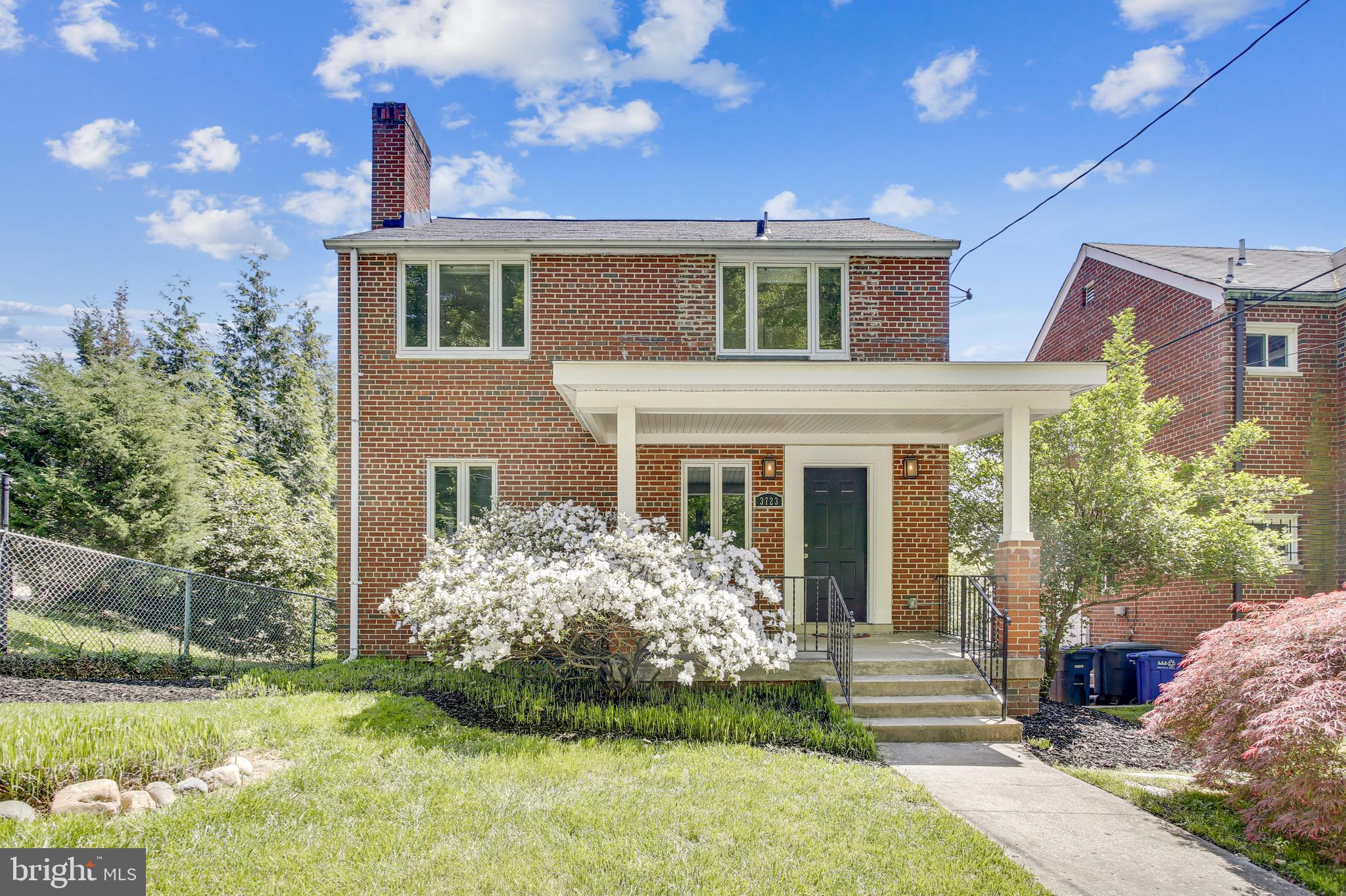 Discover peaceful living with this 3bd/2br brick gem in Brookland! Hardwood floors and large windows means PLENTY of natural light. Features include living room with brick fireplace, large eat-in kitchen, Central AC,  finished basement, 2-car garage, and sweeping backyard. Master bedroom comes with en-suite bathroom with dual sinks. Yard is Huge - Includes 2 lots to total  10,230 sq/ft with plans for large addition.  Walk to Franciscan Monastery Gardens, Monroe Street Market, 12th Street bars and restaurants, and the Brookland-CUA Metro station. <b>OPEN HOUSE SUN 1-4</b>