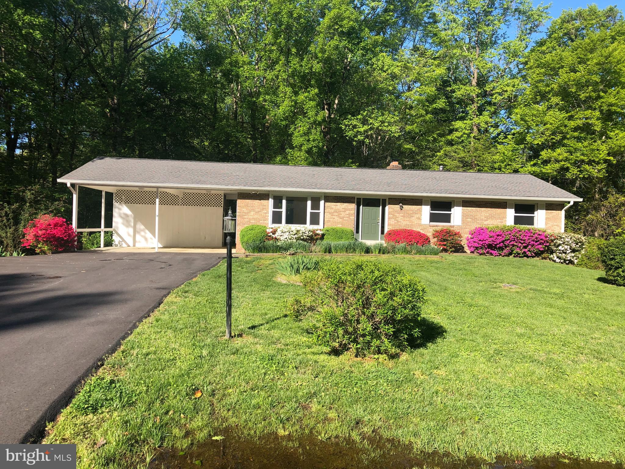 Welcome Home   Sitting on nearly 4 acres in a quiet cul-de-sac this 3 bedroom,  2.5  bath home is wa