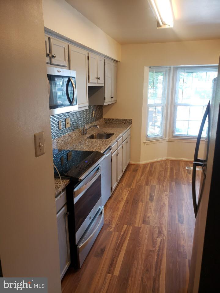 Welcome to this exceptionally large Townhome that has 3 bedrooms 3 1/2 bathrooms which is  located i