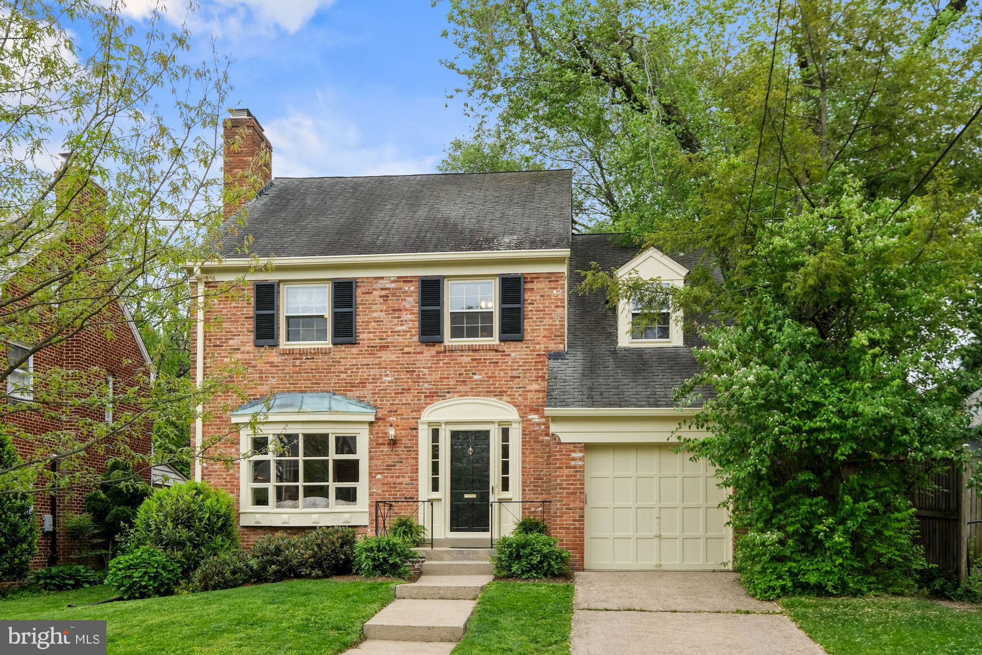 Checking all the boxes!  Stately brick Colonial with wide entry foyer, living room with fireplace an