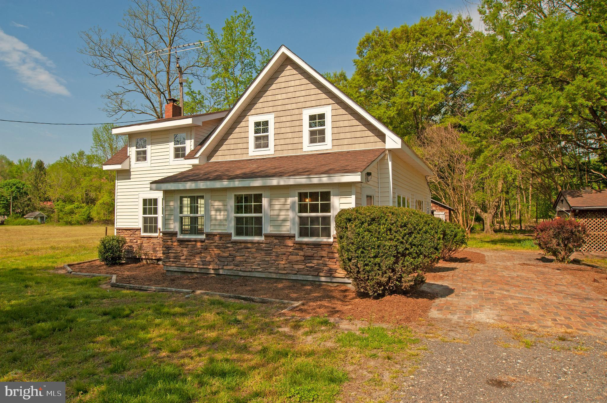 Newly renovated!! This 3 bed, 1.5 bath home is set on just over an acre of land & has been beautiful