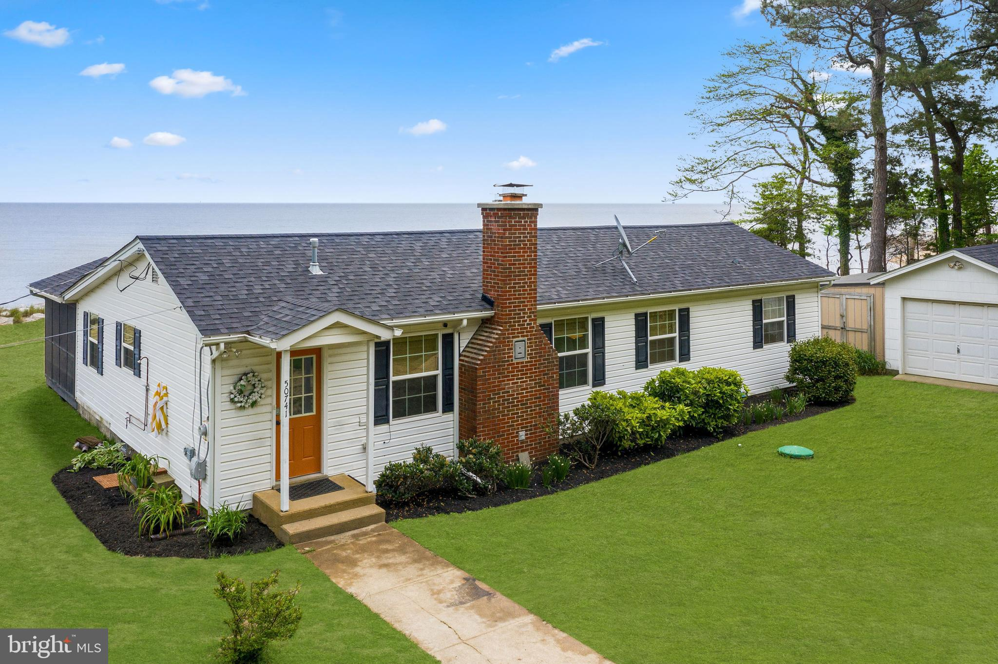 Beautiful WATERFRONT rancher on the Chesapeake Bay boasting stunning views in almost every room. Com