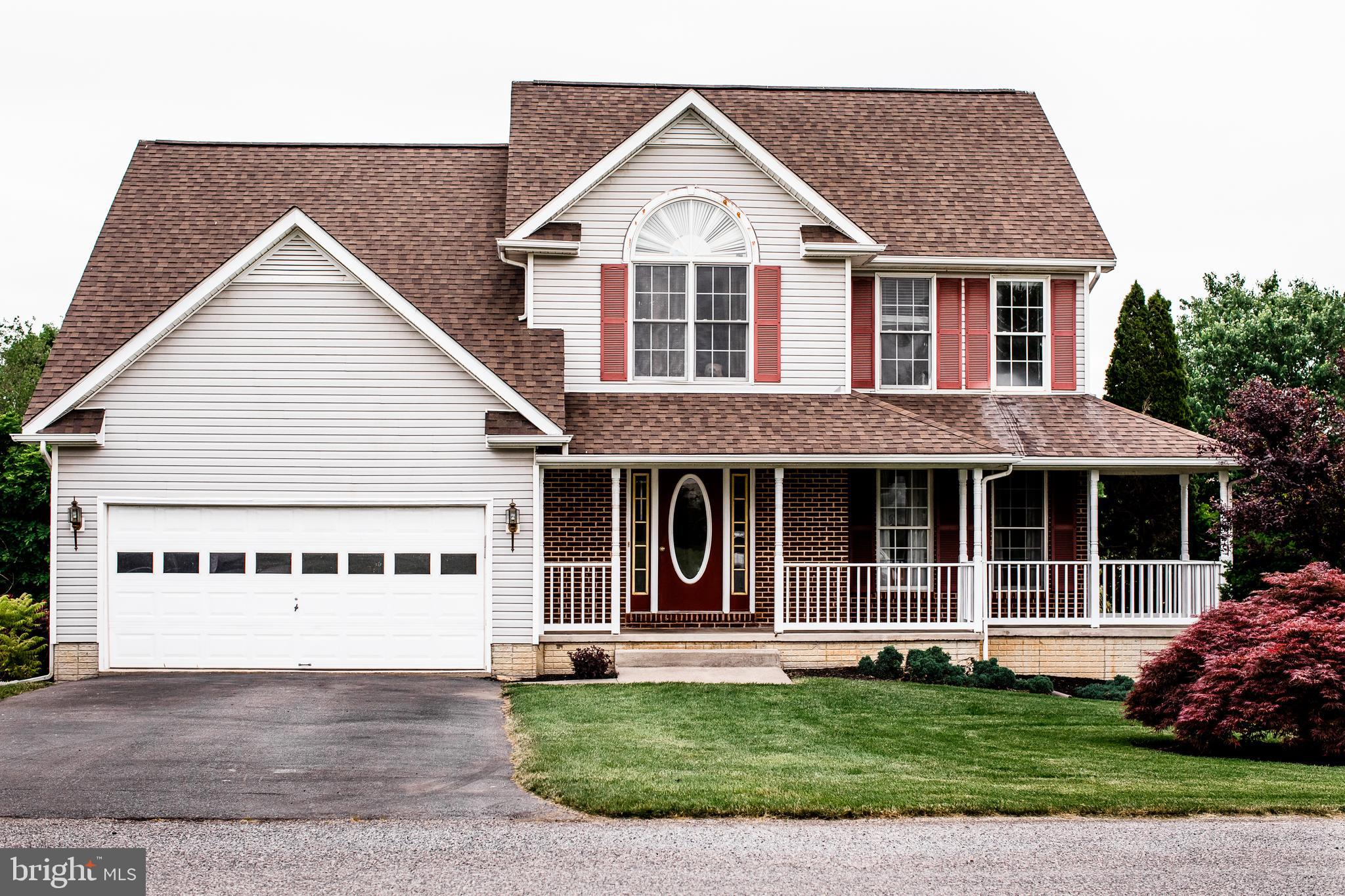THIS VERY ATTRACTIVE 4 BEDROOM / 3.5 BATH COLONIAL WITH A FULL FRONT PORCH AND DOUBLE GARAGE IS ON 1