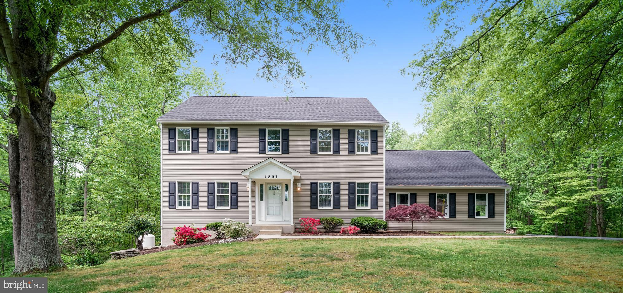 Tastefully appointed  center hall colonial with upgrades galore!  Main level features sun soaked ent