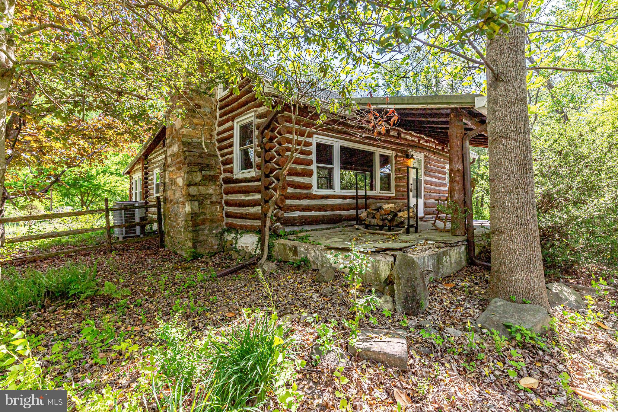 Looking for that special unique property?  This 1936 built log home sitting on nearly 5 acres along the banks of the Oocoquan River might just be the one for you.   Sitting high above Dumfries road come home to your one country retreat at the end of a long day.  This home will take you back.  The great room features a stone woodburning fireplace and opens to the loft area above.  Rustic wood flooring in main living area.  A separate DR and kitchen with table space.  Enjoy watching the various wildlife and the changing of the seasons from the Sun/Florida room.  There is a bedroom on the main level along with two full baths plus a second bedroom or home office on the upper level.  Listen to the rain hitting the tin roof.  Something calming about that.  Lots of flower beds and acres of woods to explore.  The property ends up along the banks of the River.  And all of this just a few miles to Libera with all the shopping and restaurants a person could wish for.