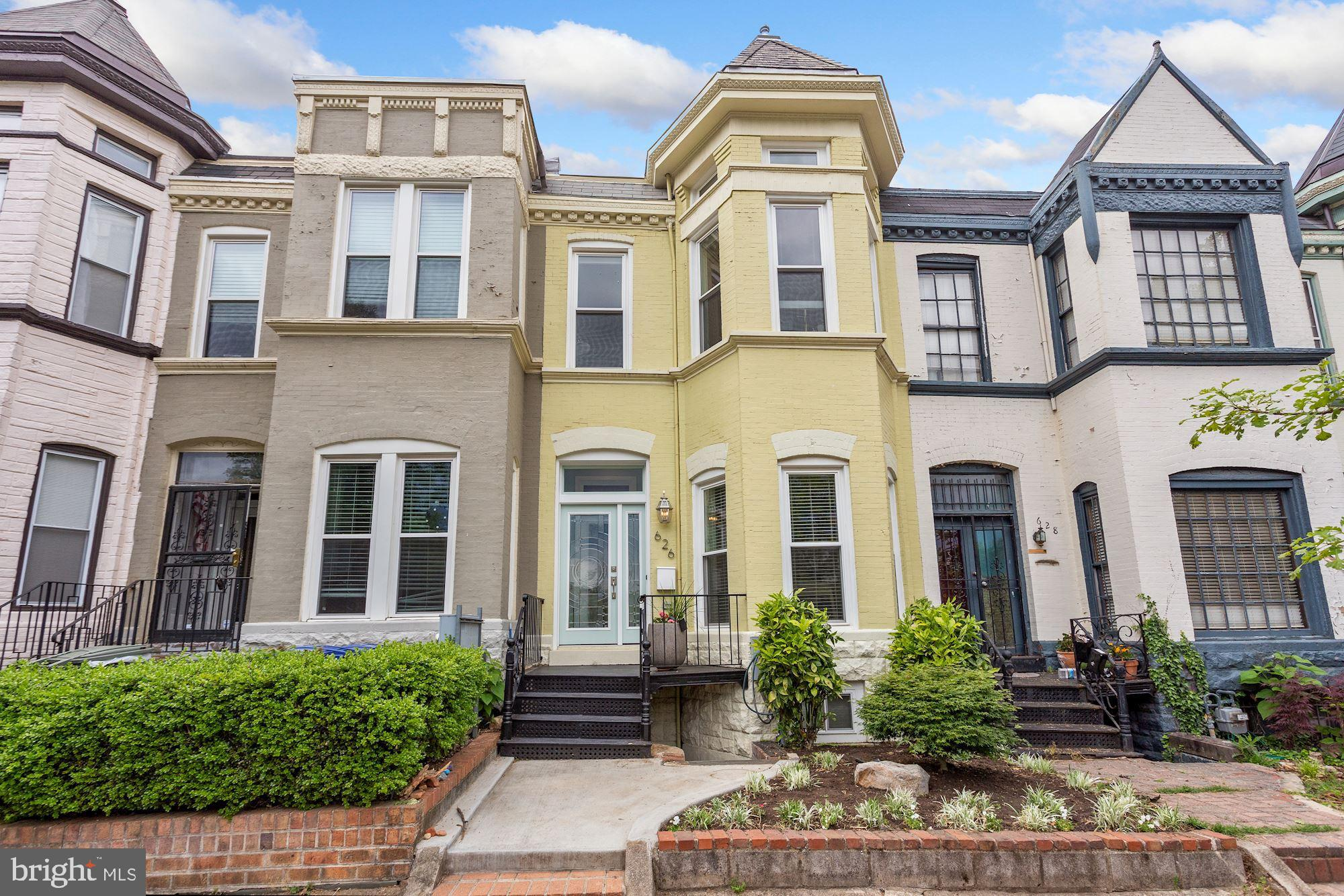 Welcome to 626 9th Street NE, a timeless Victorian townhouse on one of Capitol Hill's most charming