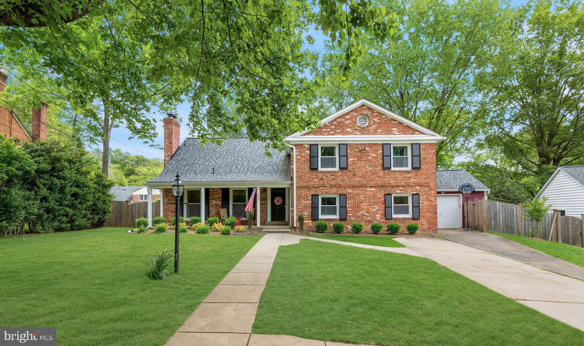 Welcome to this beautifully updated all brick 4 level split, sited on a premium quarter acre lot wit
