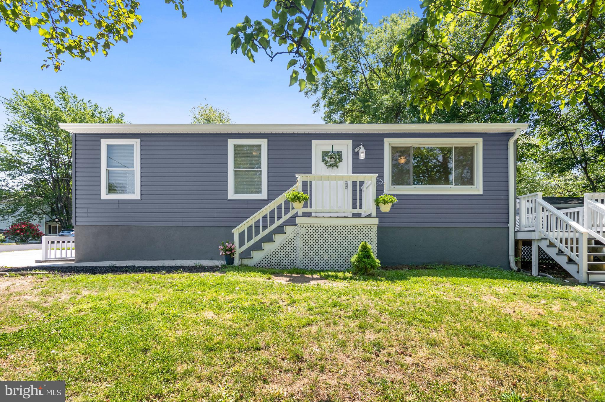 Radiant Rancher Lovingly Renovated by Owner. Upon entering the home you are greeted by cool tones, b