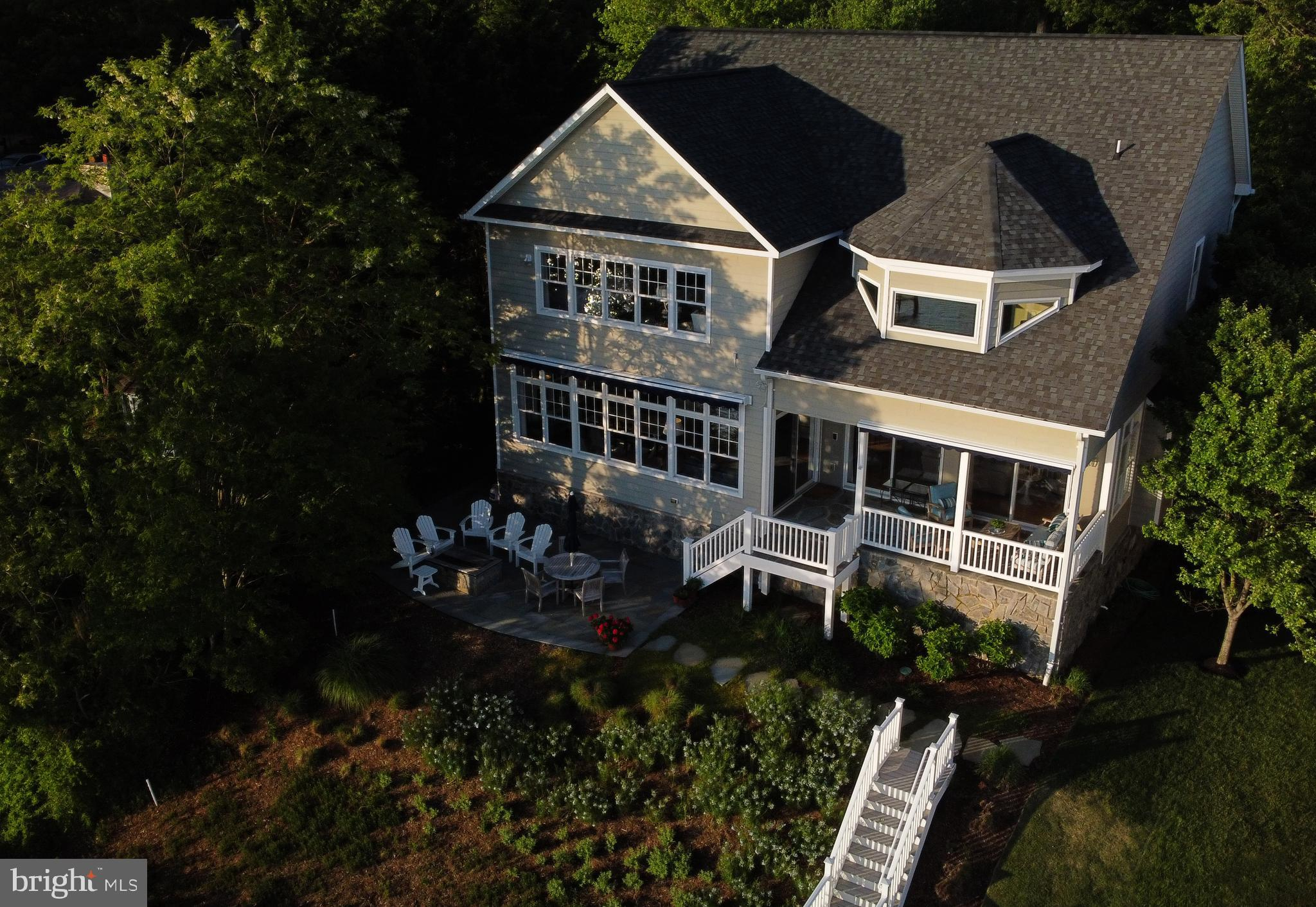 Stunning waterfront home with panoramic elevated view of the South River !!  This 11 year old home f