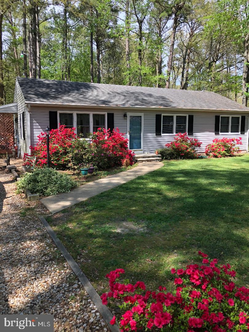 Wonderfully cared for one owner home on a quiet street in the country. Nicely landscaped treed lot.