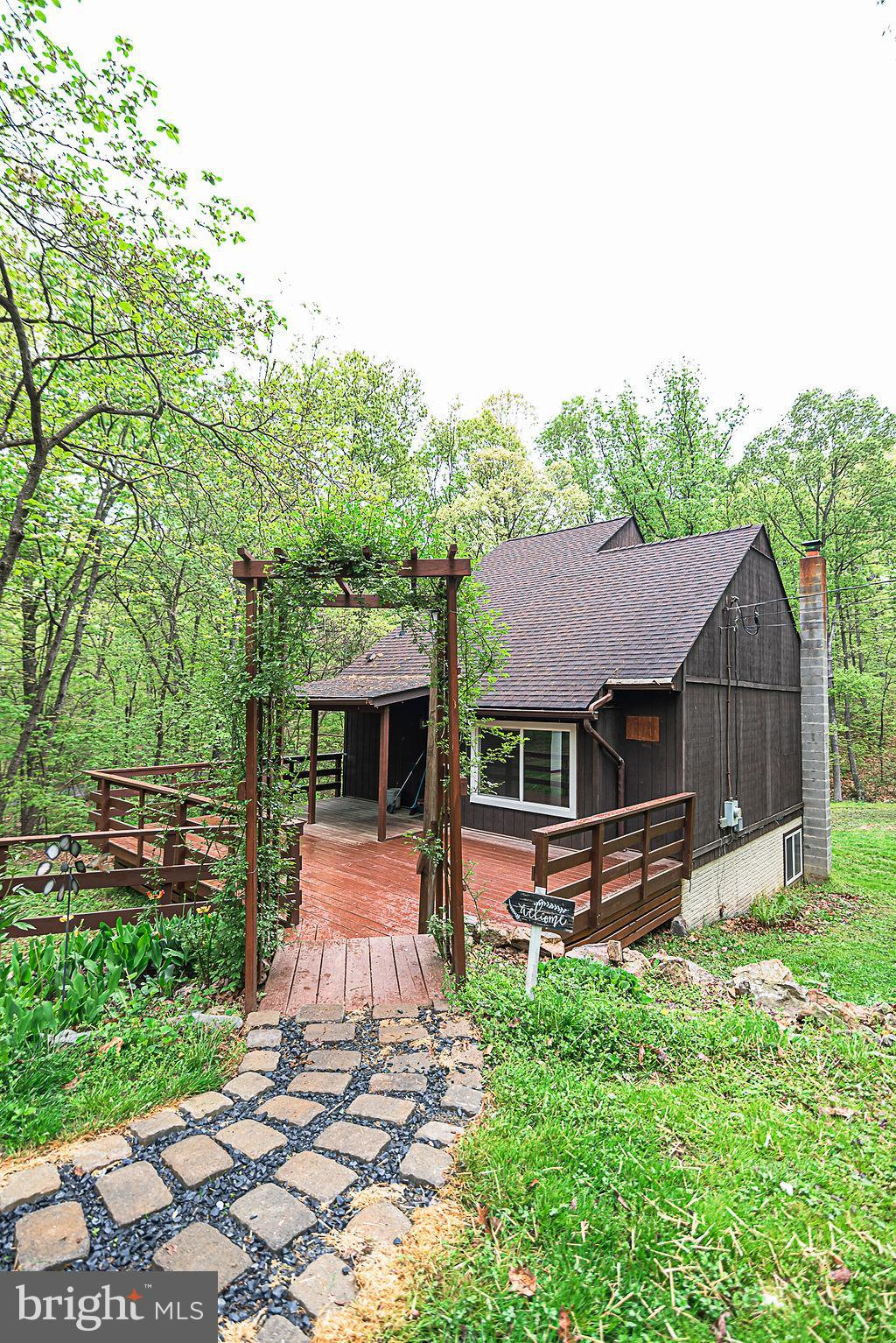 Come check out this adorable Chalet In South Berkeley County  West Virginia! Sitting on a little ove