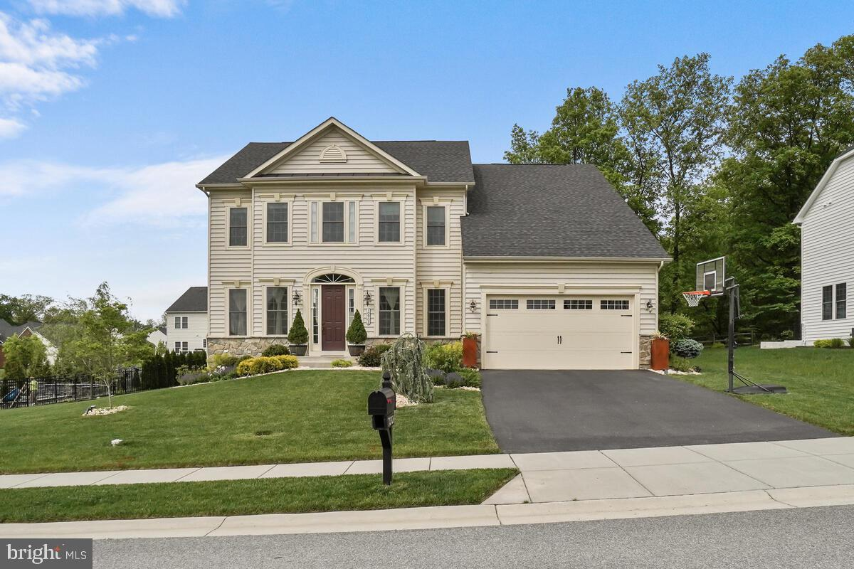 Barely lived in! Only 4 years old. Almost 4500 sq. ft, This bright and spacious home situated on a b