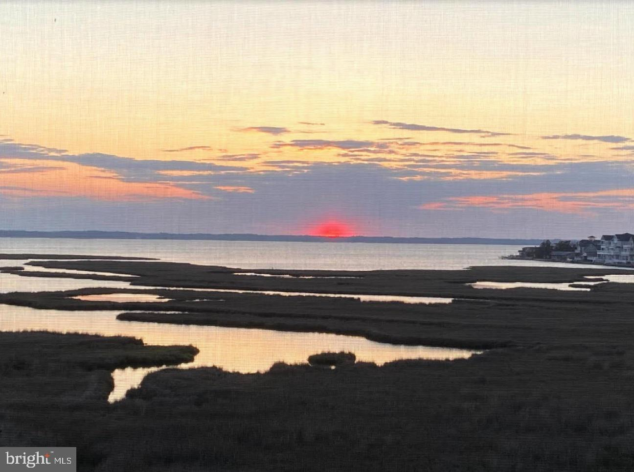 A rare find in a coveted community!  Enviable water views of the GORGEOUS Assawoman Bay with sunsets