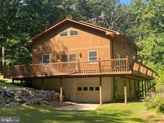 Opportunity knocks!  Turn this beautiful mountain home into your own! 2400+ sqft, 3BD, 2BA on 5.6 ac