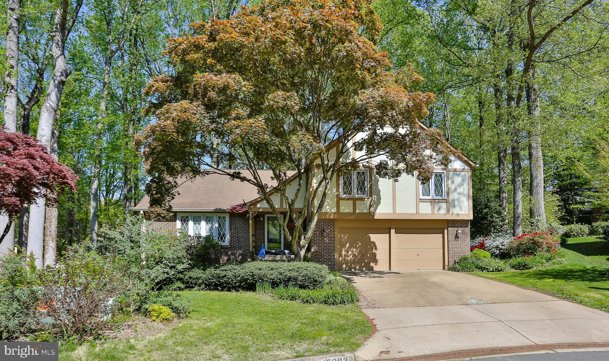 Come home to this charming home on over a third acre wooded, landscaped, level lot. sitting at the e