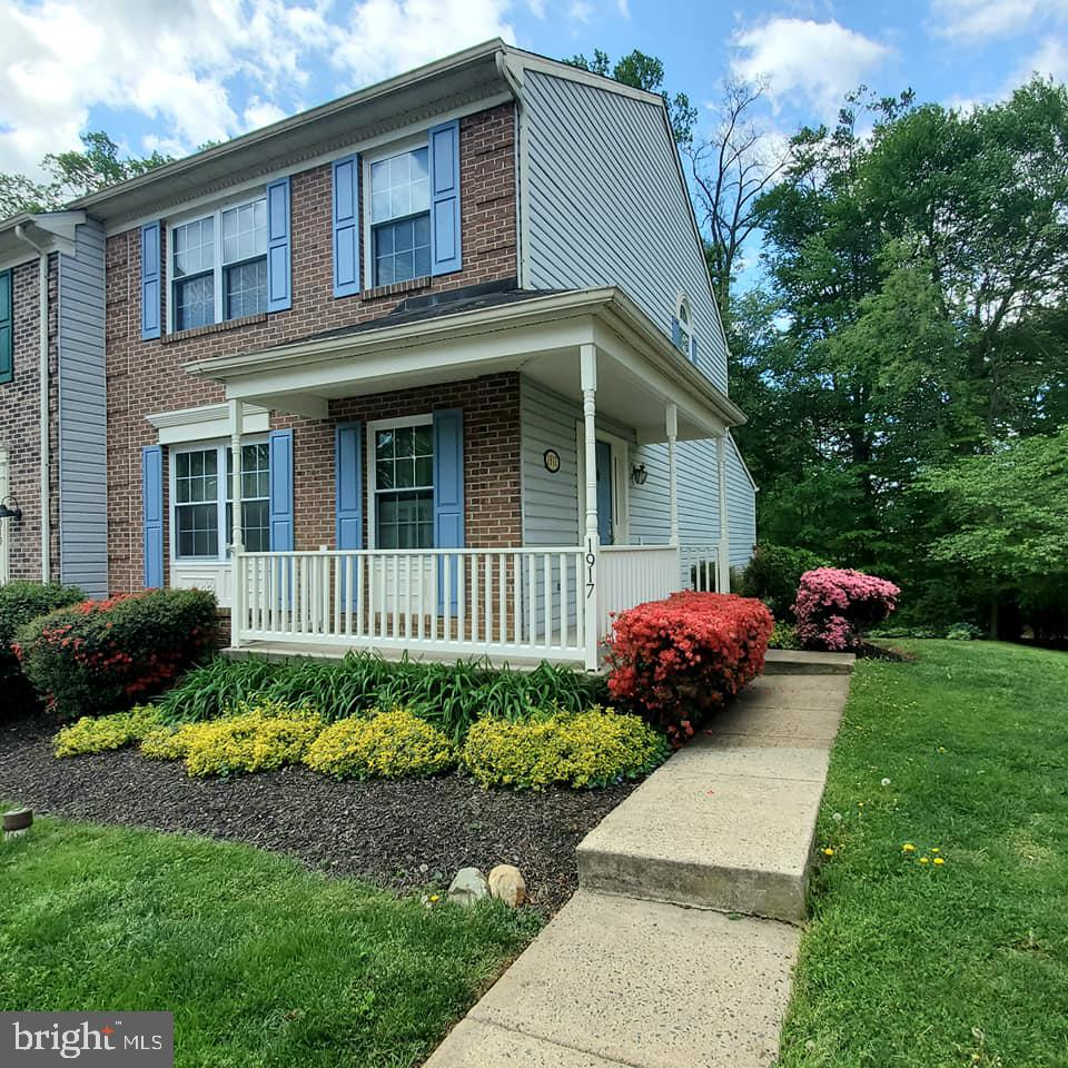 This beautiful end-unit with a 2-story, full width bump-out & a charming wrap-around porch provides