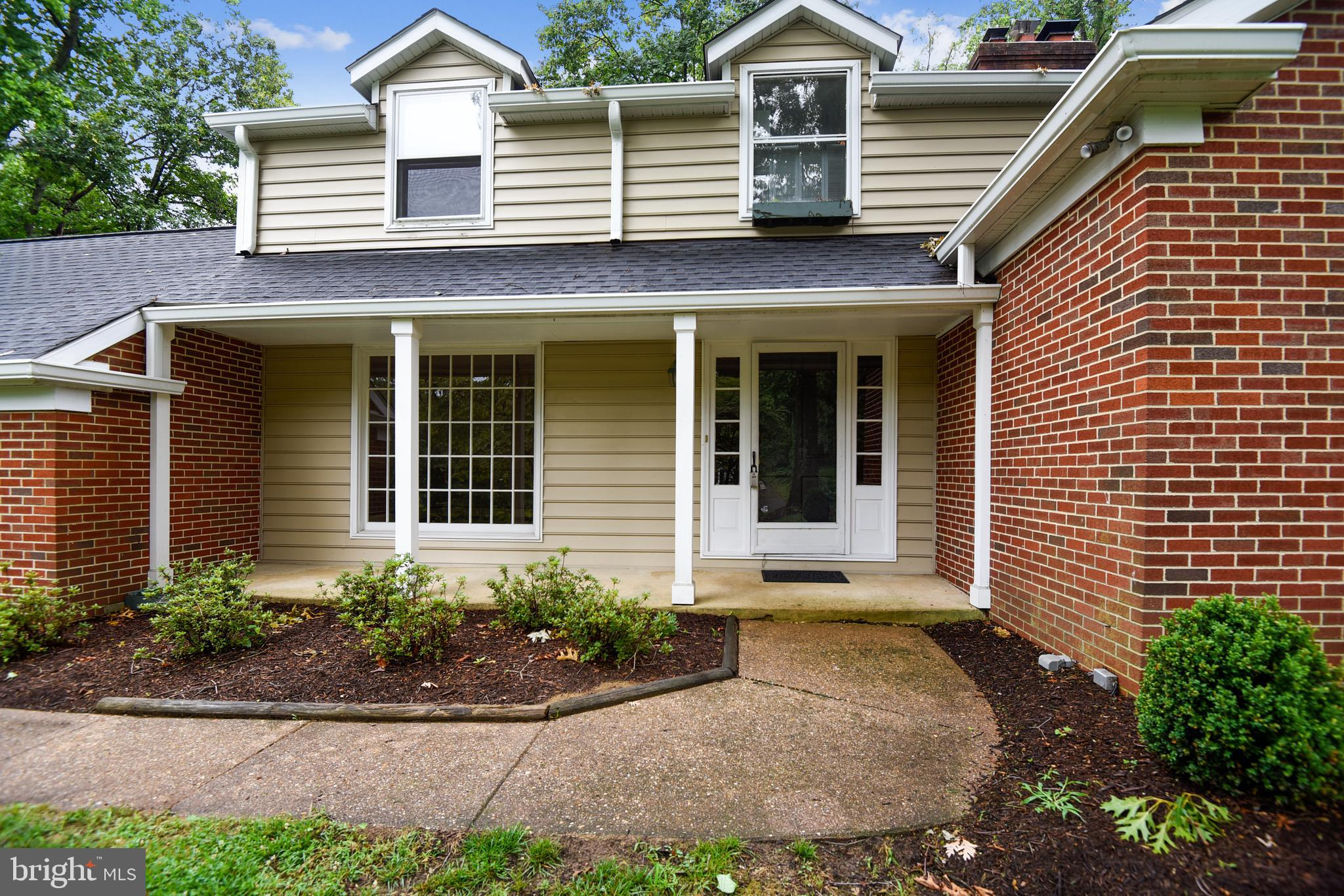 Classic brick colonial with large expanded family room open to kitchen for casual lifestyle with all