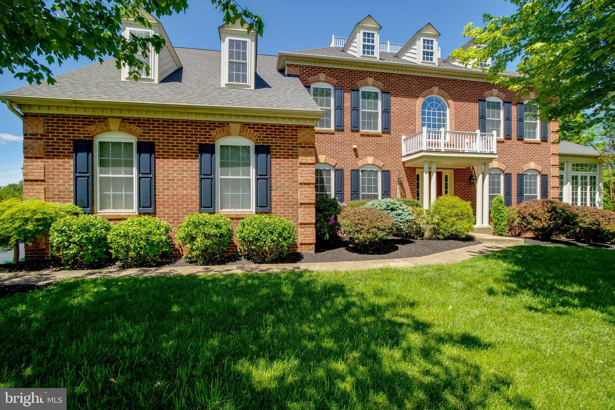 """Simply STUNNING & incredibly UPDATED 4BR/4.5BA detached home featuring OPEN, AIRY floor plan with 3-FULLY FINISHED levels boasting almost 5,800 total fin sq/ft! Stately BRICK front home with INVITING front entry with portico, 3-CAR SIDELOAD GARAGE with large driveway & brand new ROOF ('21)! Nestled in Warrenton's charming WOODS AT WARRENTON on .66-acre level, LANDSCAPED lot with AMAZING sunset & wooded views.  PHENOMENAL & PRIVATE Backyard Retreat includes maintenance-free DECK with retractable awning, multi-level CUSTOM PAVER PATIOS featuring fire pit, pergola, hot tub, retaining wall & landscape lighting! SOARING 2-Story Foyer with SUNLIT palladian window, EXQUISTE crown/chair rail/picture frame mouldings & GLEAMING HDWD flooring opens to PRIVATE Study, Living Room & Gourmet Kitchen!  Private Study with EXQUISITE crown/chair rail mouldings, recessed lighting, ceiling fan & GLEAMING HDWDs! Expansive Living Room with GLEAMING HDWDs & custom crown mouldings opens to SUN-DRENCHED SOLARIUM & Dining Room!  Builder-option SUNLIT Solarium with TRAY ceiling, GLEAMING HDWDs & WALLS OF WINDOWS with decorative transom accent windows. Spacious Dining Room boasting EXQUISITE crown/chair rail mouldings & GLEAMING HDWDs opens to Living Room & Gourmet Kitchen.  Gourmet Kitchen with AMPLE 42"""" cabinets, large center ISLAND, spacious pantry, GRANITE countertops, UPGRADED stainless appliances, recessed lighting & GLEMAING HDWDs opens to Breakfast, Family & Mud/Laundry Rooms!  Breakfast Room with PARK-LIKE treed views, SOARING cathedral ceiling with fan & GLEAMING HDWDs opens to Backyard Retreat, Gourmet Kitchen & Family Room!  Large Family Room with COZY gas fireplace, GLEAMING HDWDs & floor-to-ceiling windows with transom accents & views of SECLUDED backyard.  GLEAMING HDWD stairs with NEW carpet runner ('21) opens to Upper Level Hall with HDWDs! EXPANSIVE Primary Bedroom with TRAY ceiling with fan, SITTING ROOM, gigantic walk-in closet & PRIVATE Primary Bath!  Primary Bath with DOUB"""