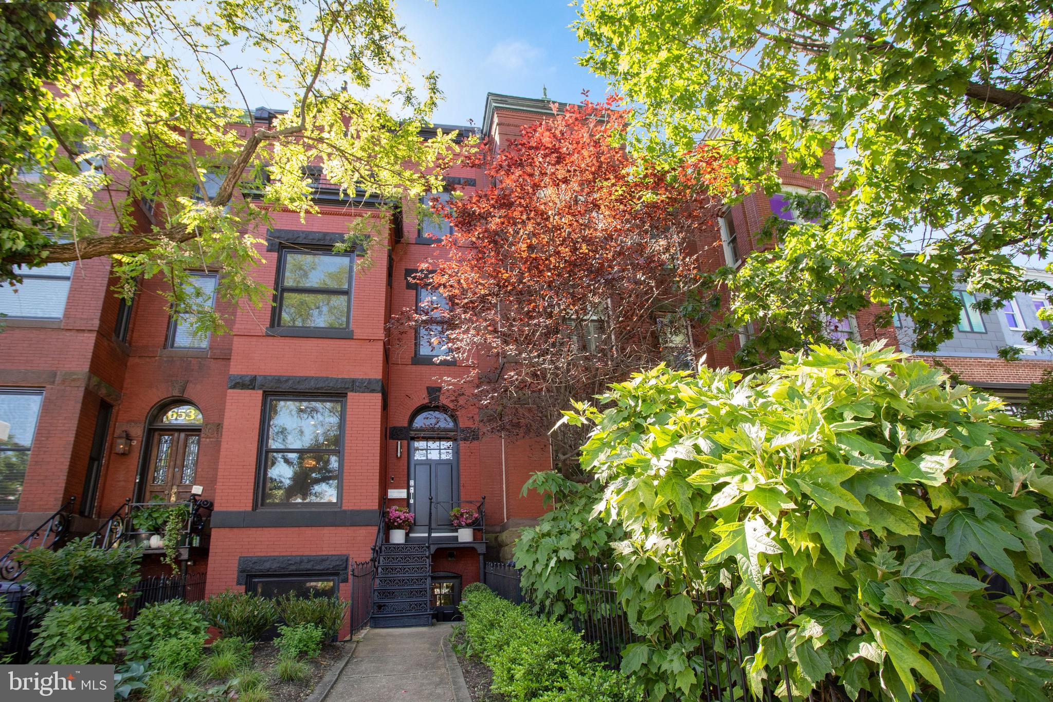 Prepare to fall in love with this top to bottom restoration!  This four level rowhome includes a gor
