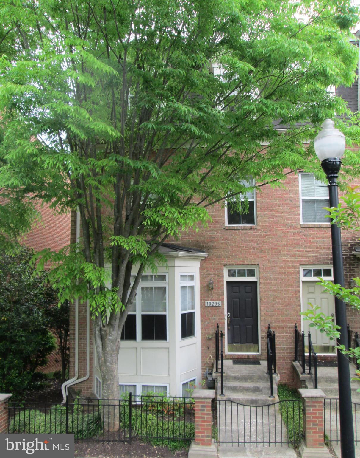 """Open House 12pm-2pm Saturday May 8th!!!  Tremendous location just off the mall!  This 4 level 2-car garage end unit  townhouse has a gourmet kitchen and hardwood flooring throughout the main level and the upper level hallway.  The main level features a living room - dining room combination and a kitchen that basks in natural light and also has a large island with breakfast bar, stainless steel appliances, including a gas stove, built-in microwave, dishwasher, and side by side refrigerator with water and ice in the door, hardwood flooring, maple cabinets with 42"""" uppers, a double sink and the kitchen flows into the main level family room with gas fireplace and rear """"morning room"""".  There is a balcony off the rear of the home on this level, too.  The hardwood staircase leads to the 1st upper level which houses 3 bedrooms including the primary bedroom with a soaring vaulted ceiling, walk-in closet and ensuite super bath.  Your private bath has dual sinks, a deep whirlpool tub, and separate shower.  There are also 2 other bedrooms and a full """"hall"""" bathroom on this level.  Go upstairs to the 2nd upper level to the loft, which can be used as a 4th bedroom, an office, a library/study, a children's playroom, guest bedroom or whatever other purpose you might come up with.  The """"loft"""" is a great space and there is also has a half bathroom up there.   The home has 2 """"zones"""" for AC and heat, both with gas furnaces ... so the 2 upper floors and the 2 lower floors have separate  thermostats for better efficiency and better temperature regulation throughout the home.  The lower level has a recreation room, a half bath and the laundry room.  Interest rates are great and this 2-car garage townhome in the heart of Town Center is a great place to live.  Easy access to shopping, jogging/walking trails, lakes and other outdoor recreational activities including concerts at Merriweather, the movie theater and restaurants at the mall.   Community fees include yard maintenance, snow remova"""