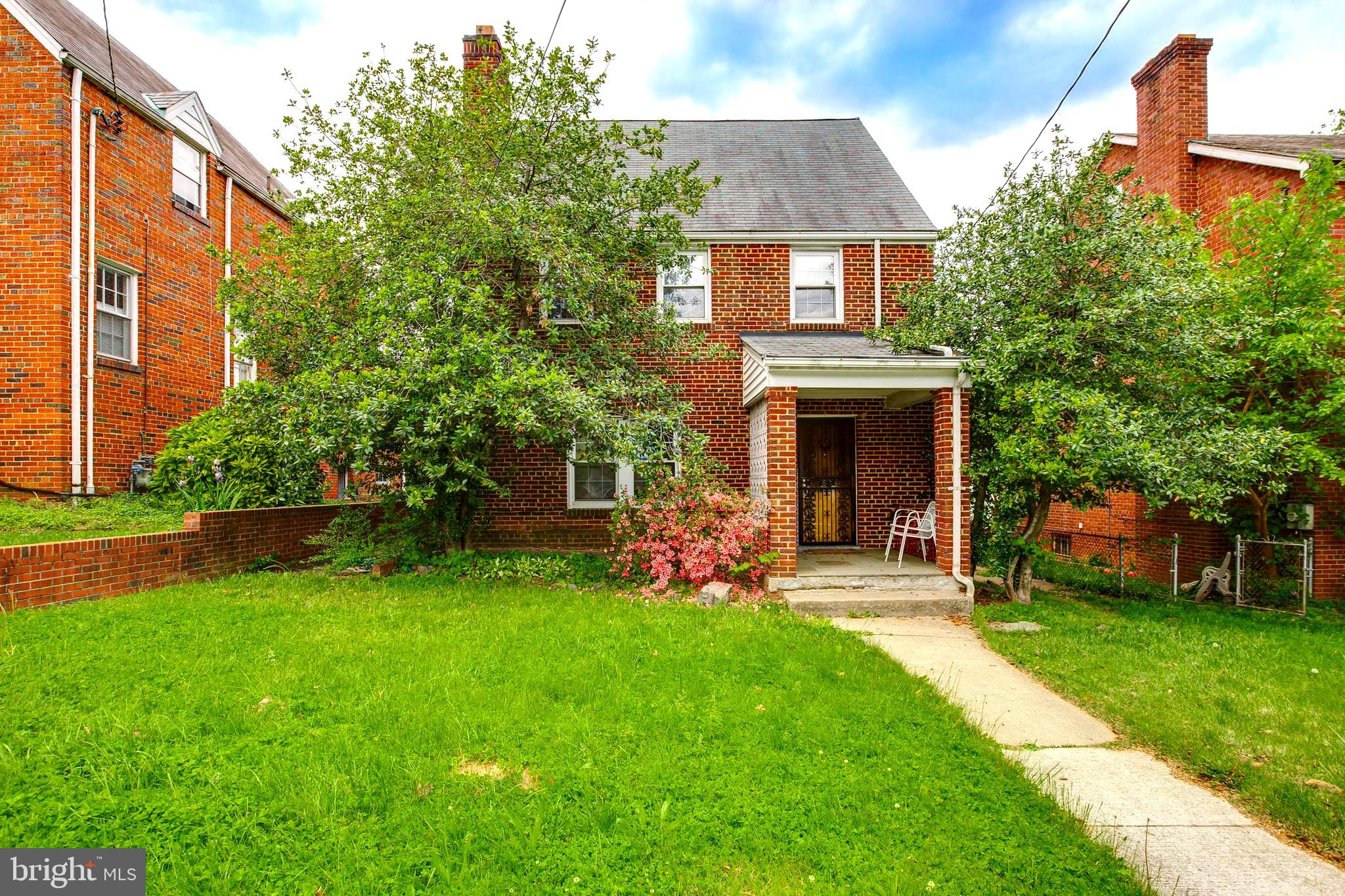 Nestled in treelined Michigan Park, this detached, brick,  4 level colonial welcomes you at the fron