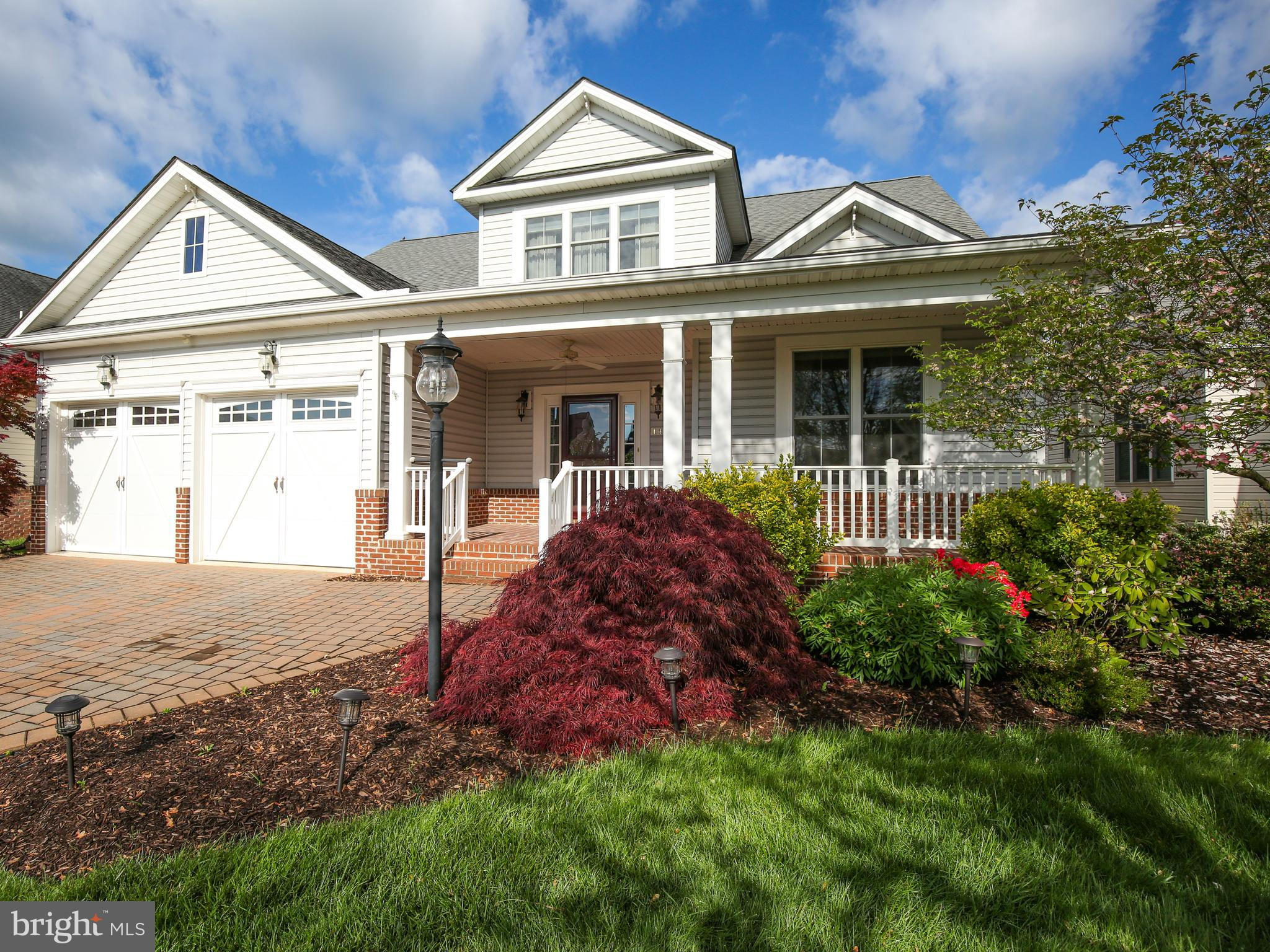 Impeccable home in 55+ community.  Gracious living is personified in this home with all the essentia