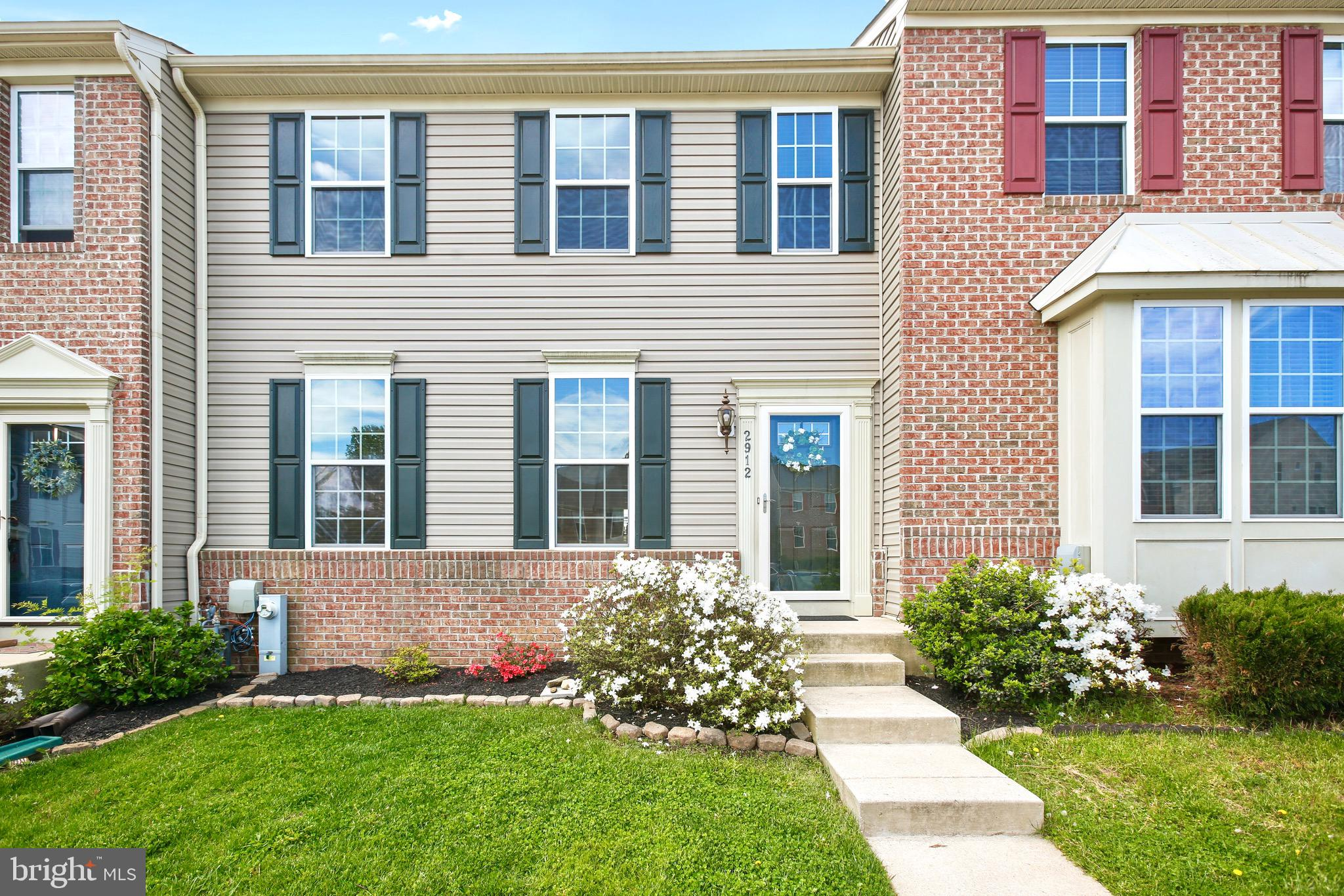"""This Gorgeous, 24' Wide, """"Move-In"""" Ready, Partial Brick Front, 3 Bdrm / 3.5 Bath, 3 Lvl Townhome Off"""