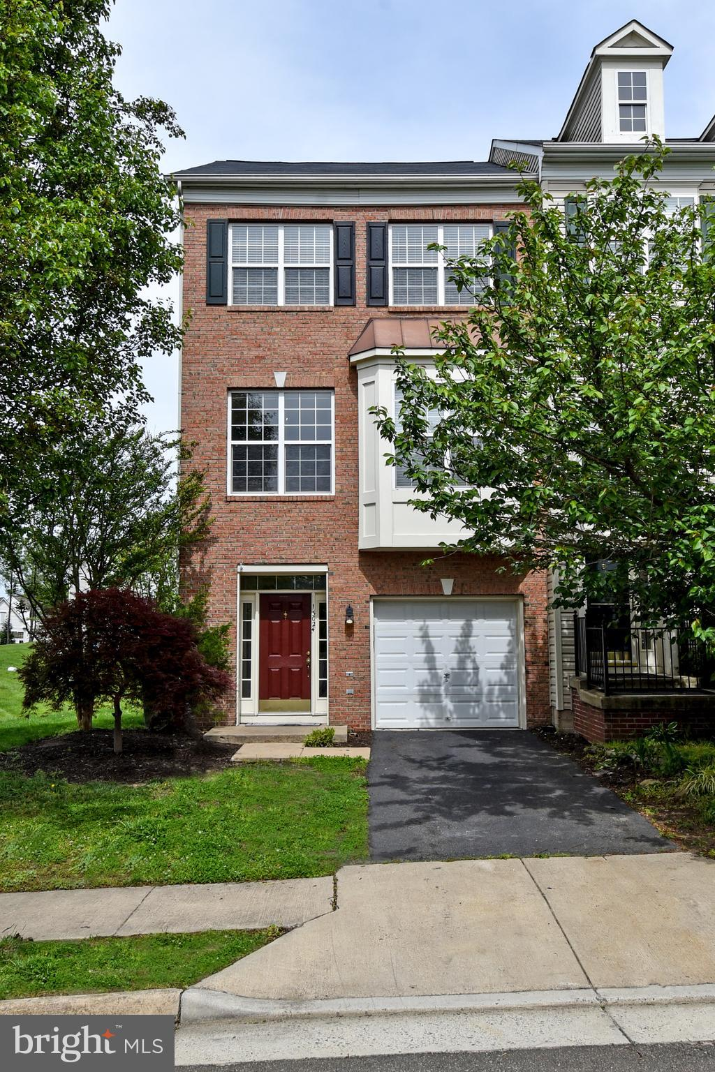 Expansive end unit brick front townhome with nearly 2300 sq. ft. of finished living space on 3 floor