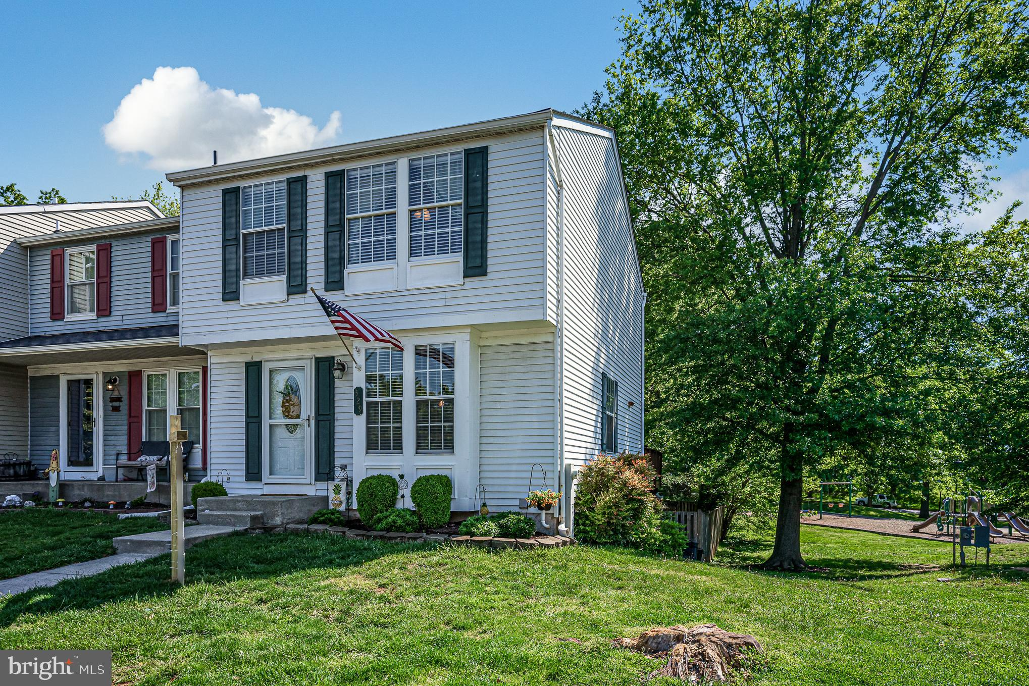 This beautifully updated end of group townhome is move in ready for you and your growing family!!  If you have been looking in this neighborhood, you'll notice that this house has the best parts of every house including a fireplace, optional 4th bedroom in the basement, 2 full and one half baths, end of group, a walk out basement, fenced in yard, community playground right out back, close additional parking, a new roof granite countertops, new appliances, and fresh paint throughout!!!   We expect this house to sell quickly so contact the listing agent to reserve a time to take a look or come to an open house.