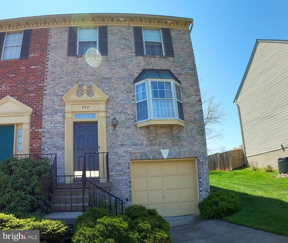 Welcome Home To Your Beautiful Brickfront Townhome in Old Fields.  This property boasts two large be