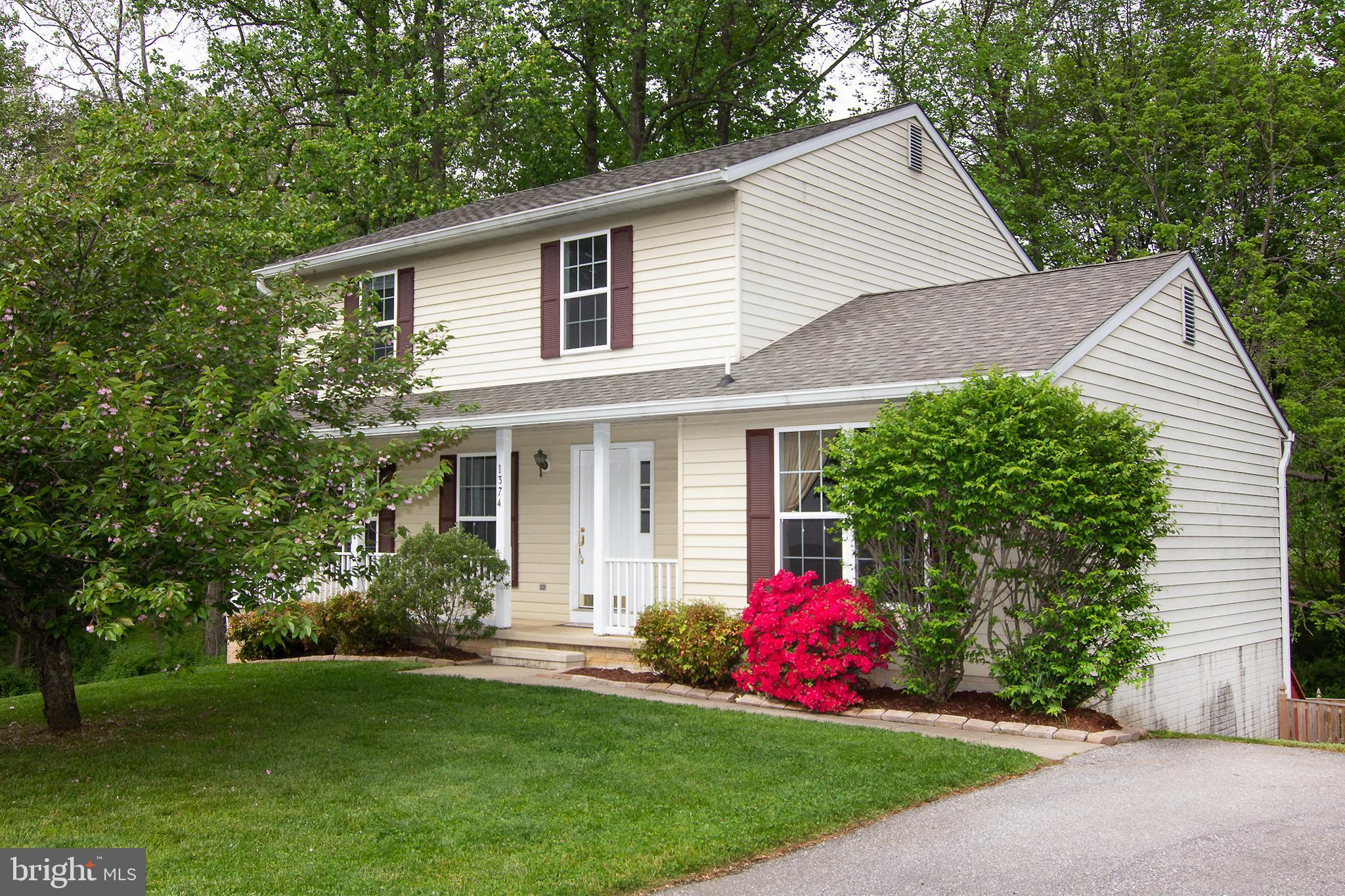 WELCOME TO THIS CHARMING COLONIAL * LIVING ROOM WITH HARDWOOD FLOORS AND SELLERS HAVE ADDED A PICTUR