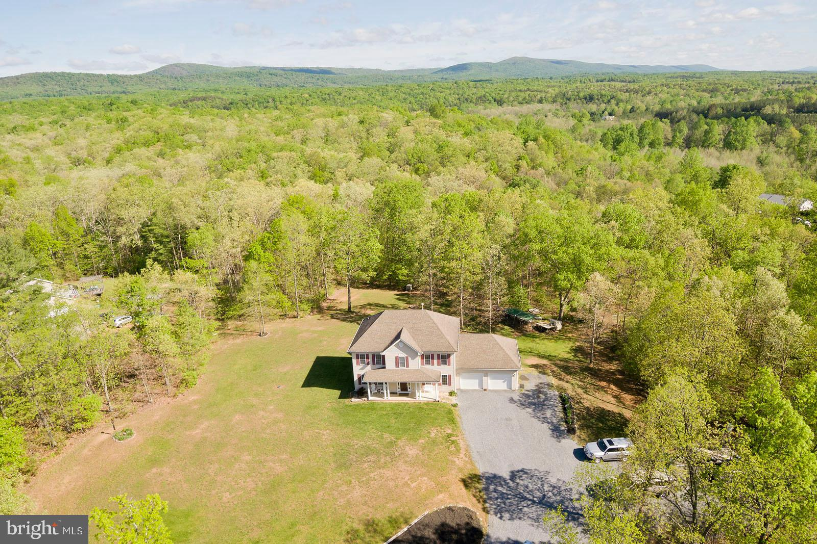 Want to get away? Enjoy country living in this 4 Bed /2.5 Bath Colonial located on almost 6 acres wi