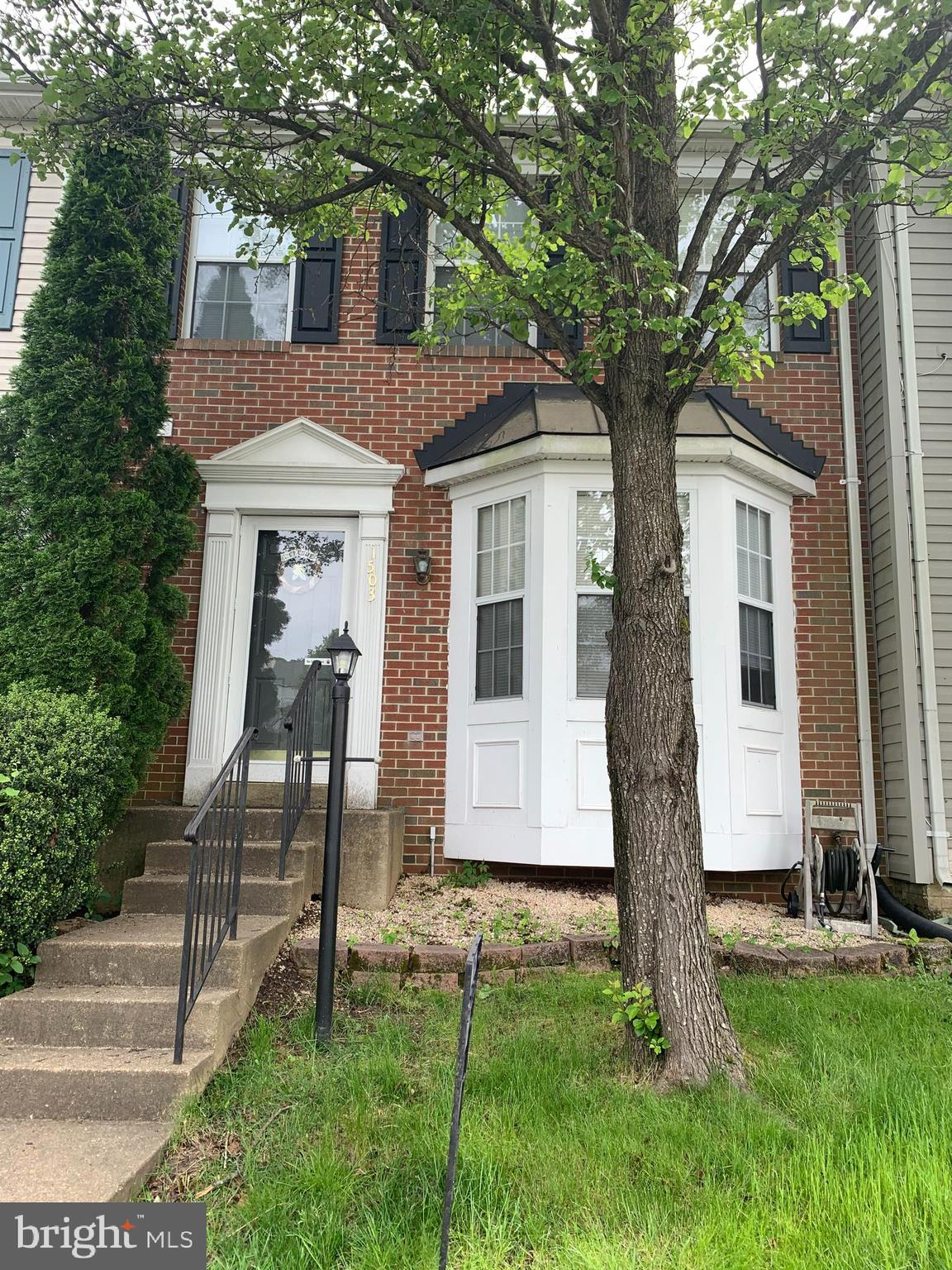 Spacious 3 level, brick front town home!  3 bedrooms with 4th NTC bedroom in lower level. 3 Full Bat