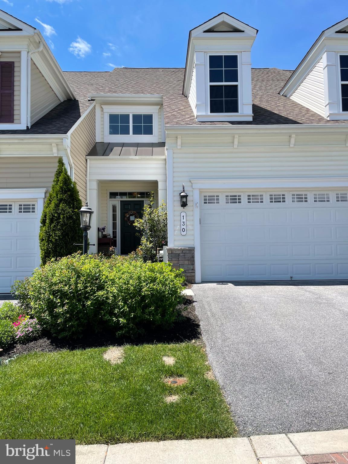 Lovely 2616 SF Villa with hardwood floors throughout the main level, which flow to the sliders from