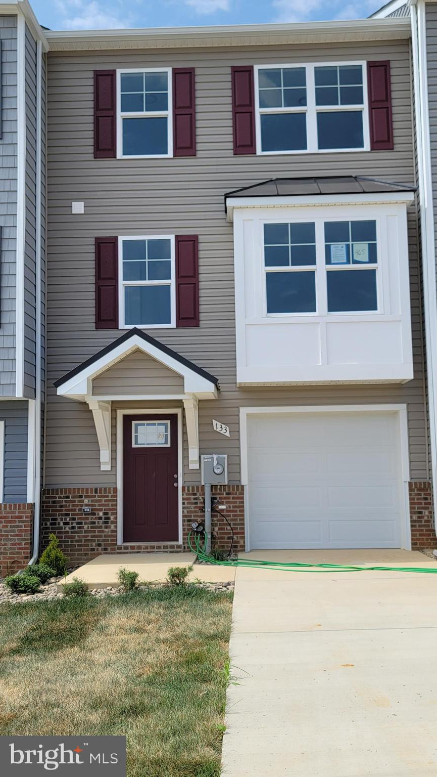 30 Day Delivery!! The Berkeley II. This 4 bedroom, 3.5 bath garage  townhome has an open concept des