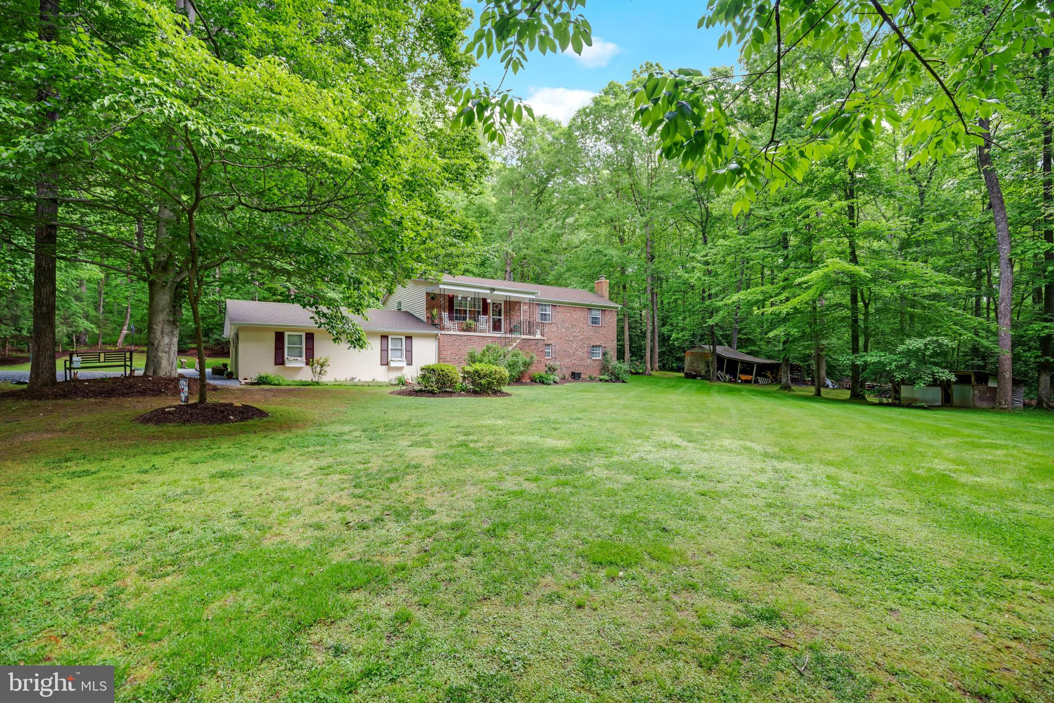 Don't miss out on this meticulously maintained home on over TWO acres in sought after Mechanicsville