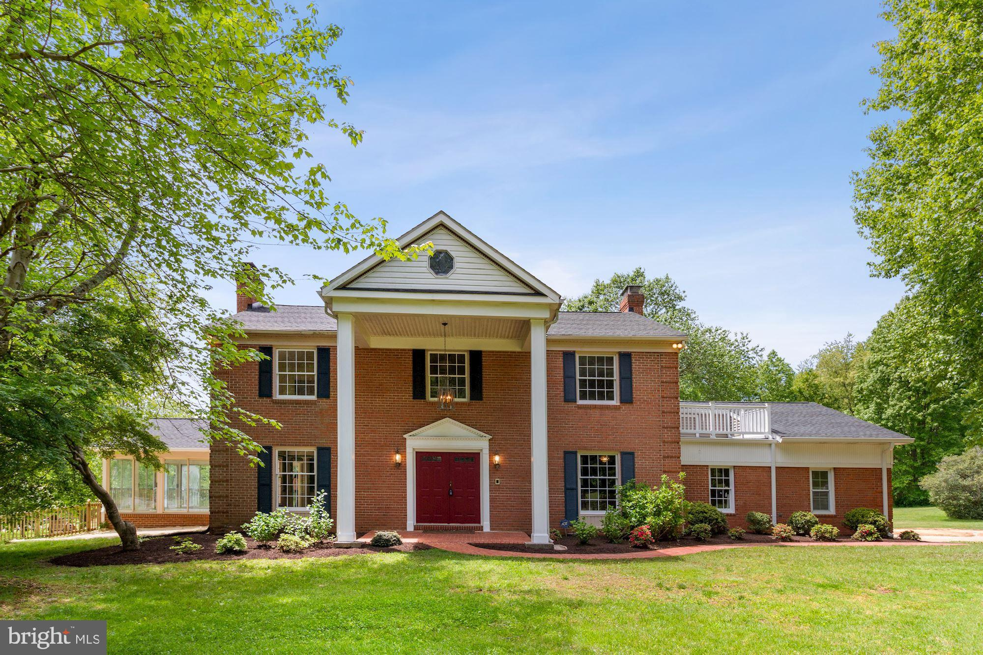 Welcome to your rural oasis! Classic 5 BR, 4.5 bath all-brick colonial with over 5000 sq/ft of livin
