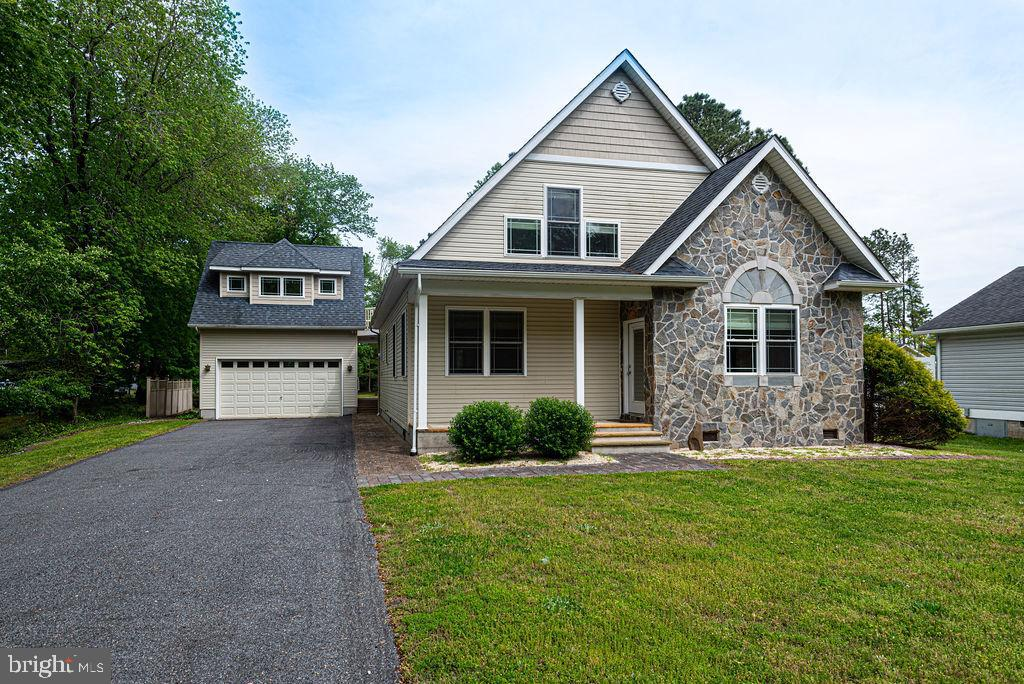 No HOA fees in this spacious Mike McCarthy custom built home in Ocean View Delaware which is conveni