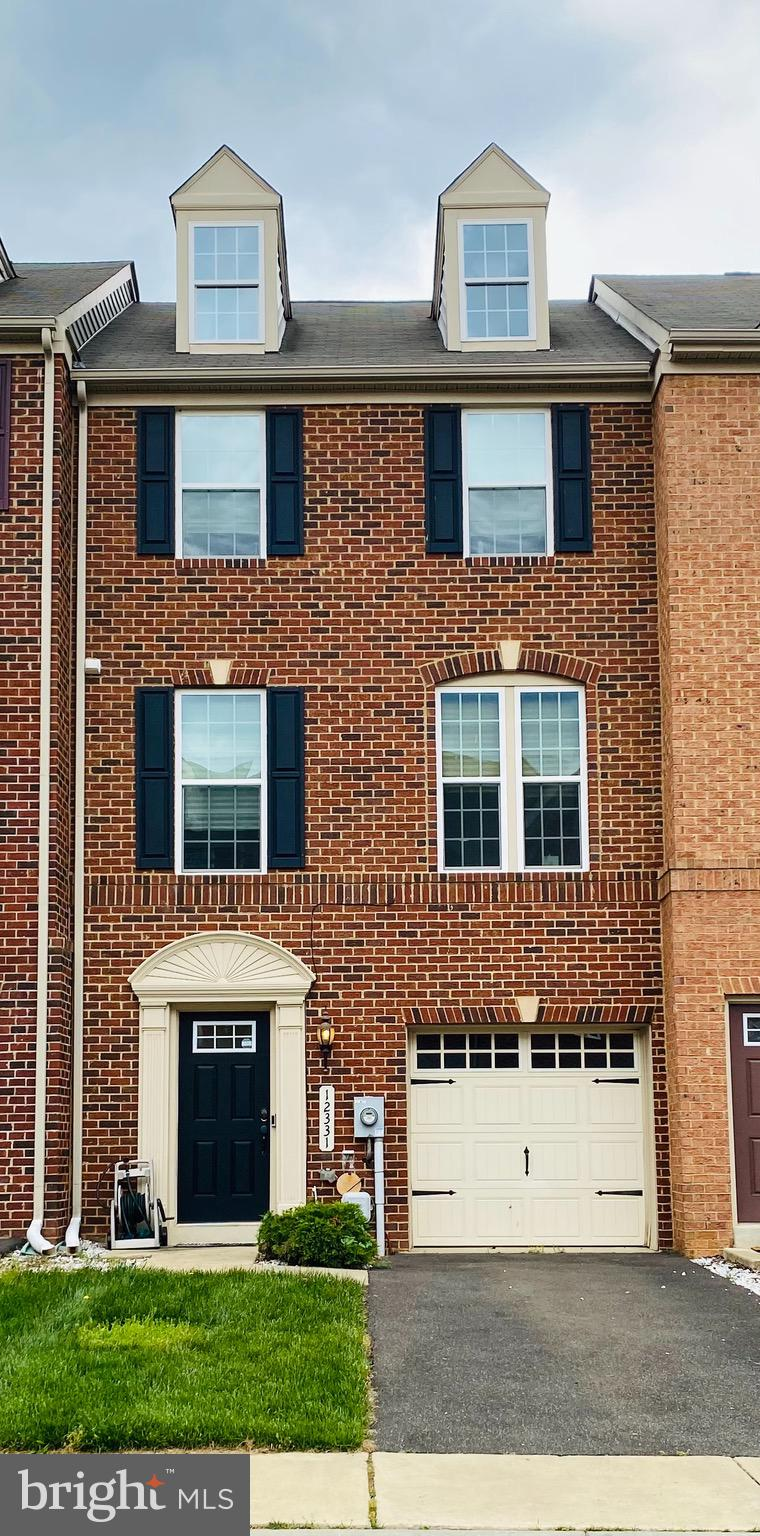 Welcome home to your beautiful townhome! this three-level townhome is conveniently located in the Ad