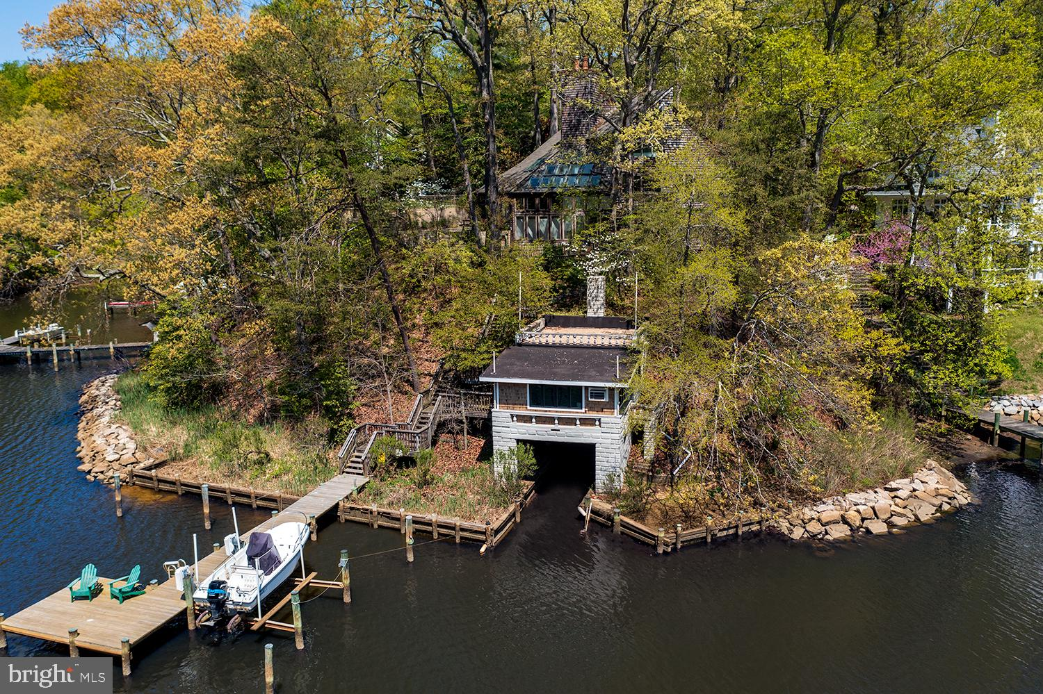 The Consummate Private Epping Forest Escape! Contemporary home with 5 Levels of Living Space plus Loft with private Deep Water Pier, 10,000 lb boat lift & RARE boat house with renovated waterfront party room all in One of Annapolis's prime real estate communities!  Bulkheaded Shoreline,  rare flat sunny yard space perfect for gardening  and expansive outside patio space for summer entertaining and barbeques overlooking scenic Saltworks Creek off of the Severn River.  Waterfront Great Room with balcony & Woodburning fireplace. Fully renovated Kitchen, Anderson Doors & Pella Windows, Updated and Zoned Heat and AC and Roof.   Entrance/Main Level Bedroom And Full Bath.   2 Car Garage Conveys with deeded Easment.   Epping Forest is a Gated Waterfront Community on the Severn River with a  communal beach, Clubhouse, Tennis, Marina and the best neighbors you can find in Annapolis!  Year around activities include 4th of July Fireworks,  Oyster & Bull Roast, Boat Club,  Summer Volleyball League, Kayaks & summer camps.  Come Experience the best  Chesapeake Bay Maritime Annapolitan Lifestyle around!