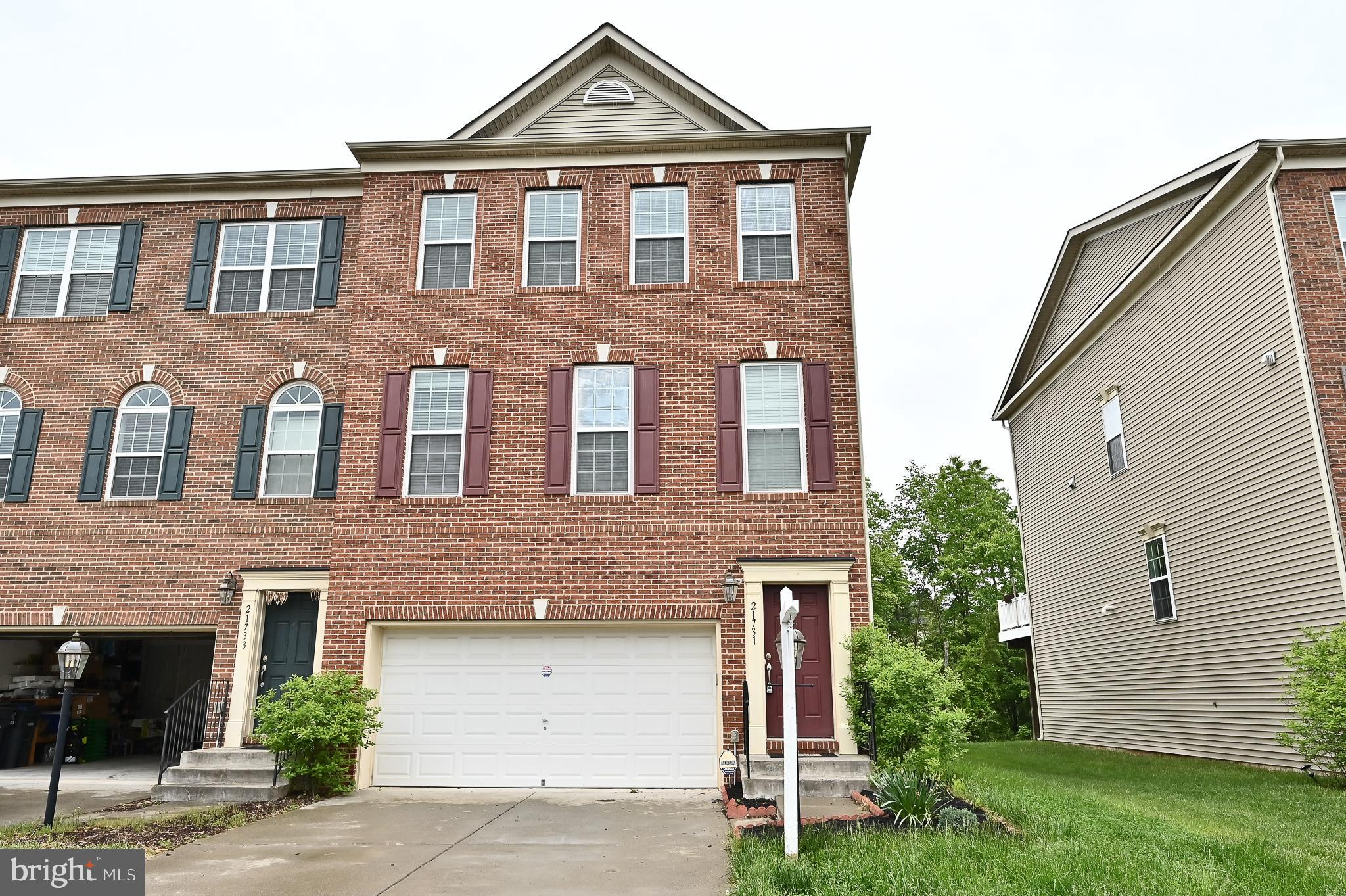 Welcome home to 21737 Loganberry Ter, Broadlands, VA 20148, this end unit townhome in the Village of