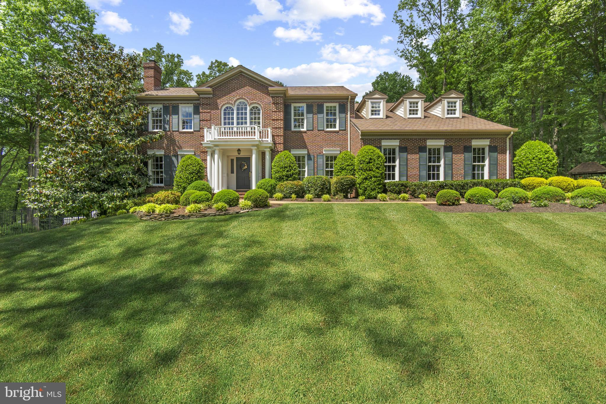 Stunning Colonial style custom home with recent updates, located on a 2 acre secluded lot off of Hen