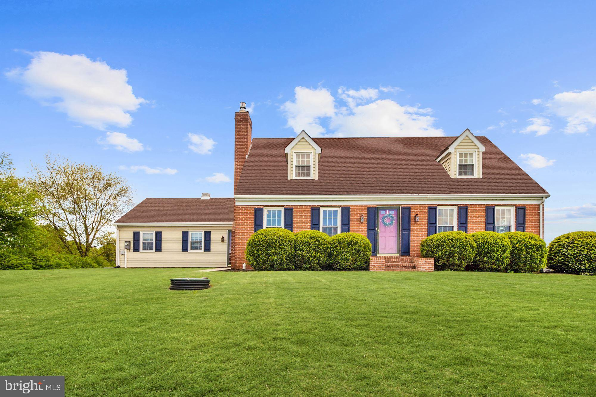 Gorgeous renovated colonial situated on 1.25 acres offering hardwood floors, crown moldings, and sun