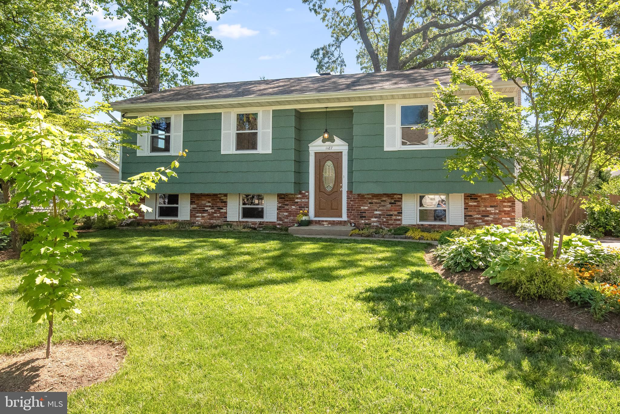 This is one very pretty yard front and back manicured and meticulous. The updates are throughout the