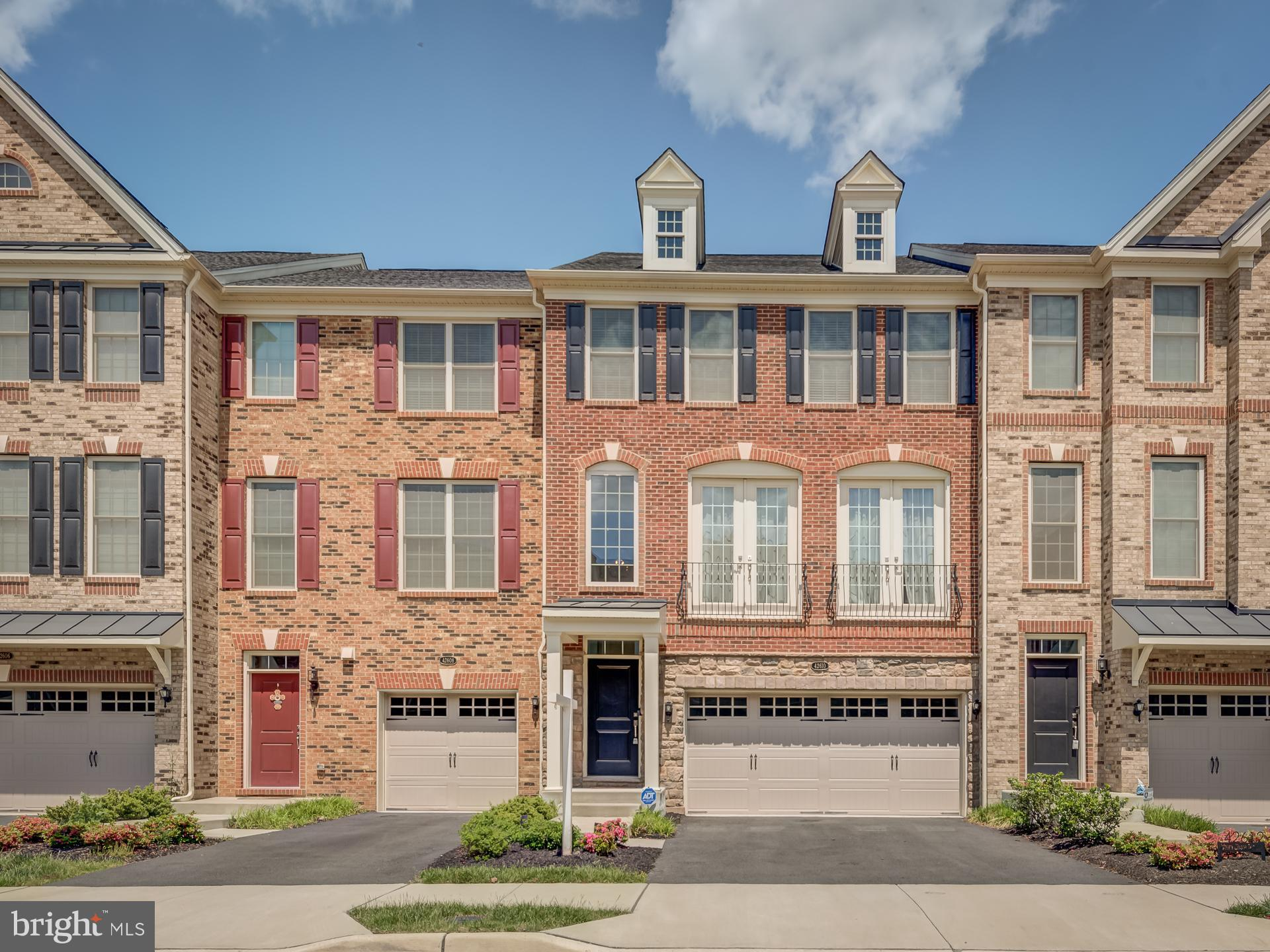 *Back Active  - Prior Buyer lost financing* Welcome home to this immaculate 3 Level 3 BR/3.5 BA Bradbury Georgetown unit with a stunning brick front in the popular amenity rich Avonlea community! This literally brand new unit features close to 3000 square feet in this light filled home that features tons of upgrades! This Turn-Key home features extensive upgrades including: Sparkling Hardwood flooring, upgraded kitchen with SS appliances, double oven, Nest system, built-in microwave, granite countertops with an oversized island perfect for early morning coffee, tile backsplash, 4 burner gas cooktop, upgraded powder room. The main floor features a open floor plan, the entry level features a 2-story foyer with a walkout basement. It also features wainscoting in the dining area and crown molding all around the living room ceiling. From the Kitchen area you can enter the spacious Trex deck with a private tree lined view! This deck will be a perfect place to spend the summer grilling and relaxing. In the Spacious master bedroom you will find an expanded French door entryway with 9+ft vaulted ceilings along with a bonus vaulted ceiling sitting room, 2 large walk-in closets, bathroom with dual vanities, upgraded countertops, shower, and separate luxurious soaking tub. Two additional bedrooms, secondary upgraded full bath, and laundry room with plenty of storage complete the upper level. Zoned heating and cooling throughout the home. The lower level has a third upgraded full bath and plenty of space to enjoy the custom maple oak bar. Walk out to the rear fenced in backyard yard with potential for another patio space. You'll love the oversized two car garage with plenty of additional storage for your recreational equipment. In addition to the garage you have plenty of parking in the driveway as well as  plenty of visitor spots! Enjoy the community pool, tennis courts, jog/walk path, pond, fitness center along with a tot lot, and so much more! Close to Rt. 50, Commuter bus lo