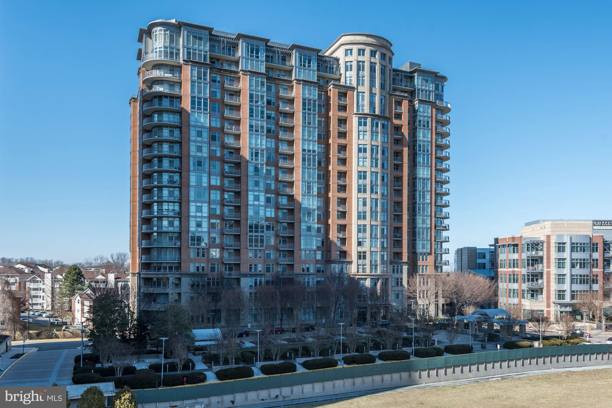 Tenant-occupied through July 31.  Tenant willing to vacate early if you wish to move in sooner than the end of July.  14th Floor Unit on the sunrise side of luxury One Park Crest in the heart of Tysons.  Expansive, open views to Maryland and Washington DC...Privacy and views that will last since the north, north-east directions will have no new high-rise buildings.  Unit features a wide living area with floor to ceiling windows plus a balcony off to the side.  A large walk-in closet to the left as soon as you enter the unit, doubles as a storage room!  Gourmet kitchen with stainless steel appliances also has an island.  Each of the 2 bedrooms has an attached bath.  The kitchen and living room feature hardwood floors while each bedroom has great carpeting.  The bathroom and walk-in closet of the primary bedroom are very spacious - Primary bathroom has dual sink, soaking tub and shower area.  Two parking spaces on P-4 level (18 and 19) convey with the unit.  One Park Crest is awash with amenities from the stately lobby area with two guest suites available for nightly fee on first come first served basis, exercise room, meeting room, courtyard - To the 18th floor swanky club room, west facing rooftop for fabulous year sunsets and adjacent roof top dipping pool.  Tysons Galleria mall is just a couple of blocks away off Park Run Dr.  The new 'Boro' development containing the mid-Atlantic region's largest Wholefoods store, movie theater, restaurants and shops is 0.6 miles up along Westpark Drive.  The Tysons Corner Silver metrorail station is 0.9 miles away with two commuter bus stops within 2 blocks of the building that take you to Tysons metrorail station.  Fast growing Tysons is uniquely situated in northern Virginia - IAD Dulles international airport is a quick 12 miles to the west; easily accessed via the nearby Dulles Toll Road.  Down town Washington DC is 12 miles south east.  The Capital Beltway I-495 is just over a mile away.