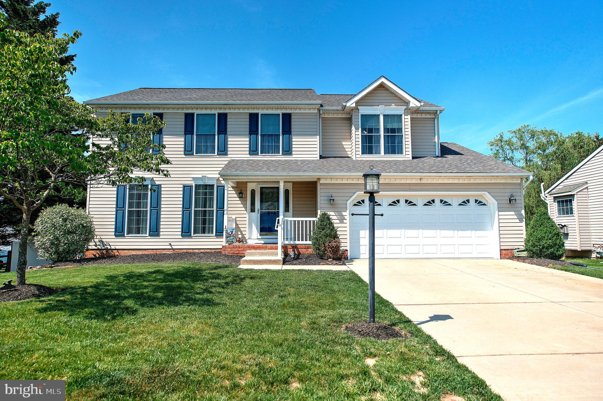 Start off the summer season with this well maintained colonial ideally situated on a  cul-de-sac lot